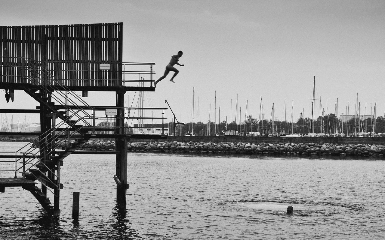 Jumping men at Kastrup Søbad in the morning. 35mm Black & White Blackandwhite Clear Sky Copenhagen Day Denmark Diving Platform Jump Jumping Leisure Activity Men Nature Outdoors People Real People Sea Sillouette Water