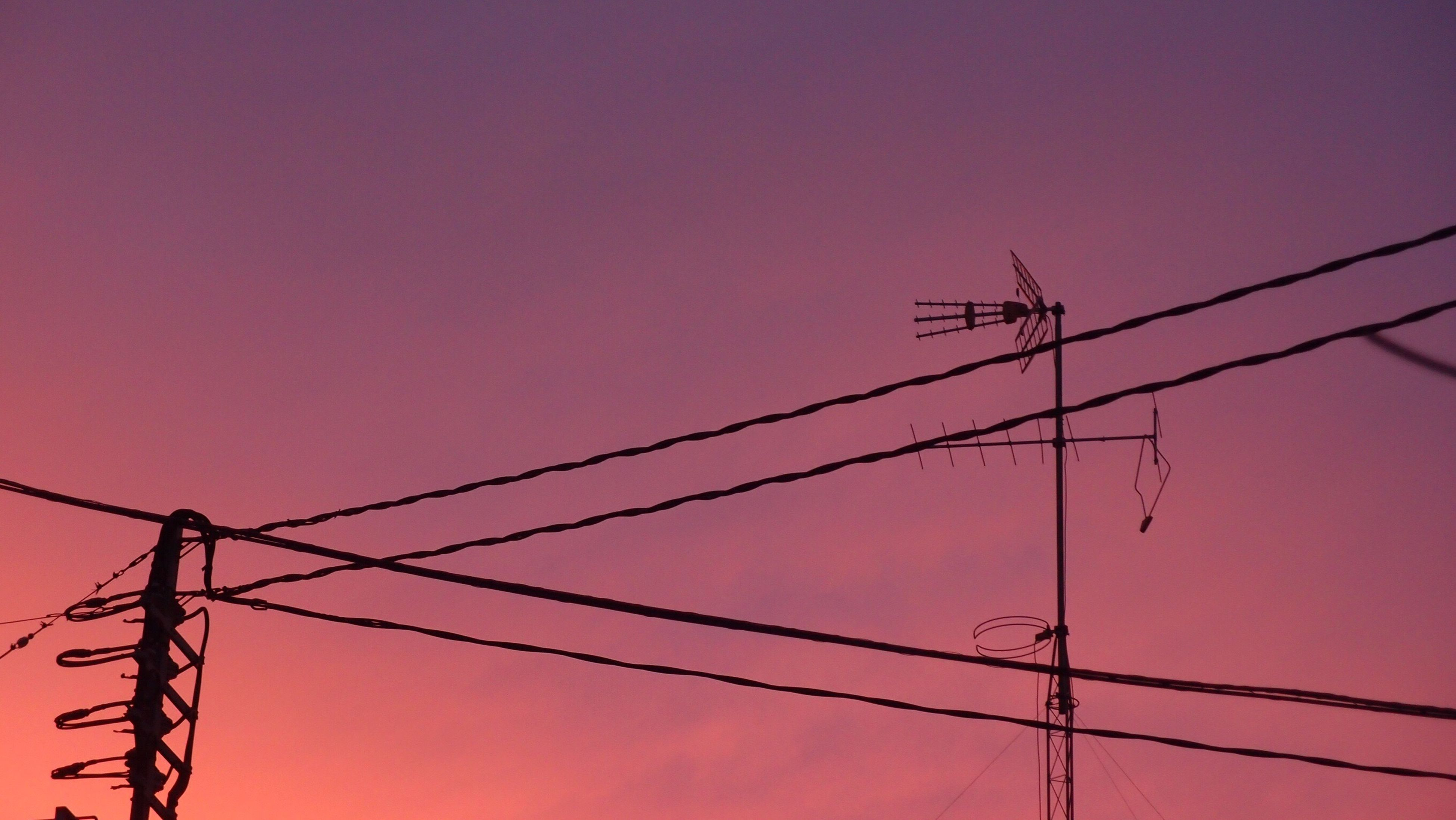 power line, power supply, electricity, electricity pylon, low angle view, connection, cable, fuel and power generation, technology, clear sky, power cable, silhouette, copy space, complexity, sunset, sky, dusk, outdoors, no people, wire