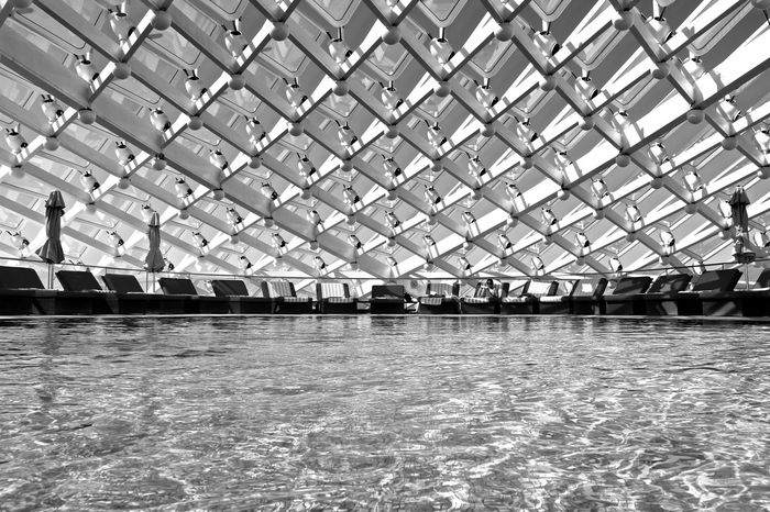 Cooling down at the pool Abu Dhabi Abudhabi Architecture Bnw_collection Built Structure Modern Outdoors Pool Time Poolside Swimming Pool Symmetrical Tranquility UAE Water YasMarinaCircuit