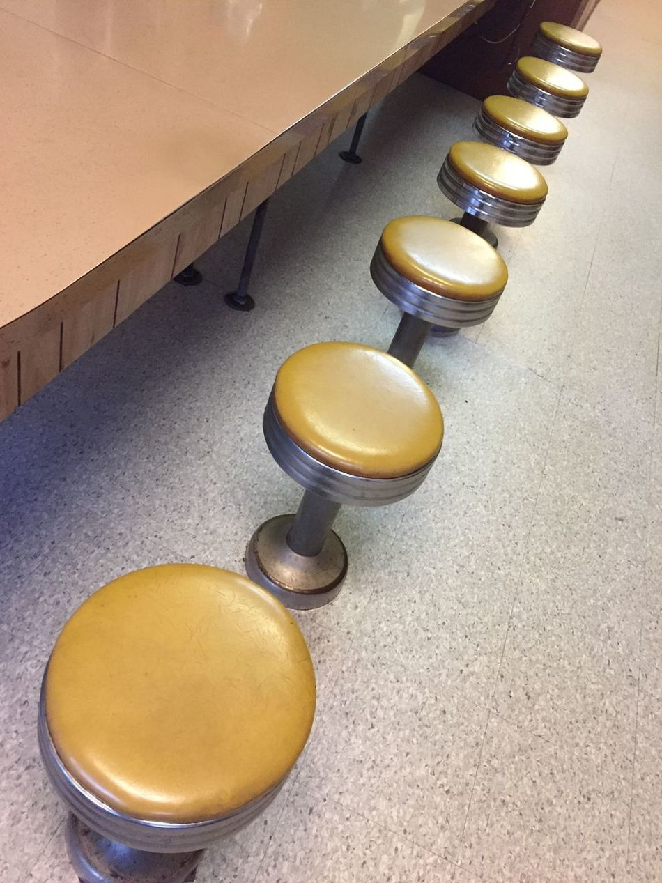 Yellow retro cafe stools Indoors  High Angle View Yellow No People Day Close-up Architecture