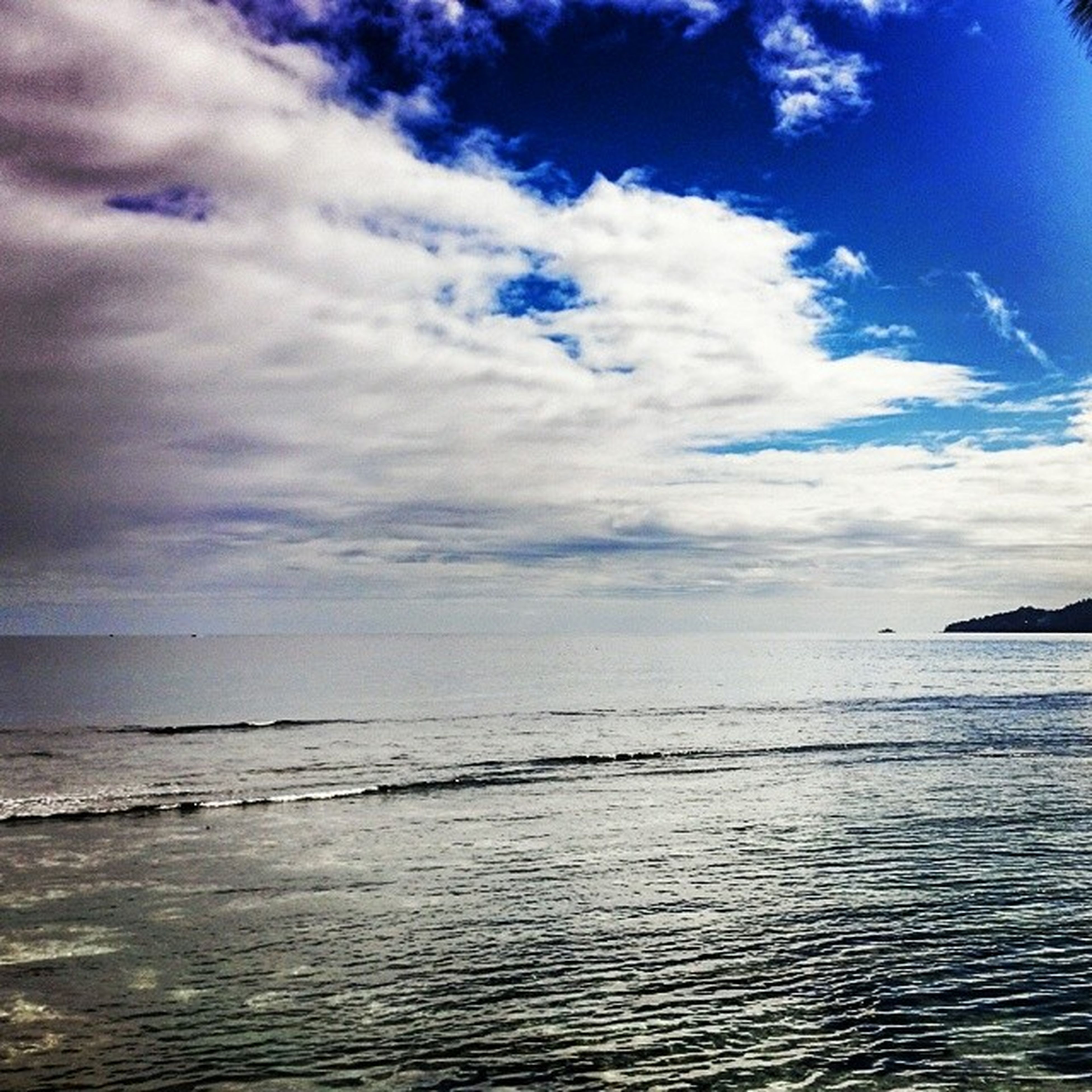 sea, horizon over water, water, sky, tranquil scene, scenics, tranquility, beauty in nature, cloud - sky, beach, cloud, nature, blue, waterfront, idyllic, seascape, cloudy, shore, calm, rippled