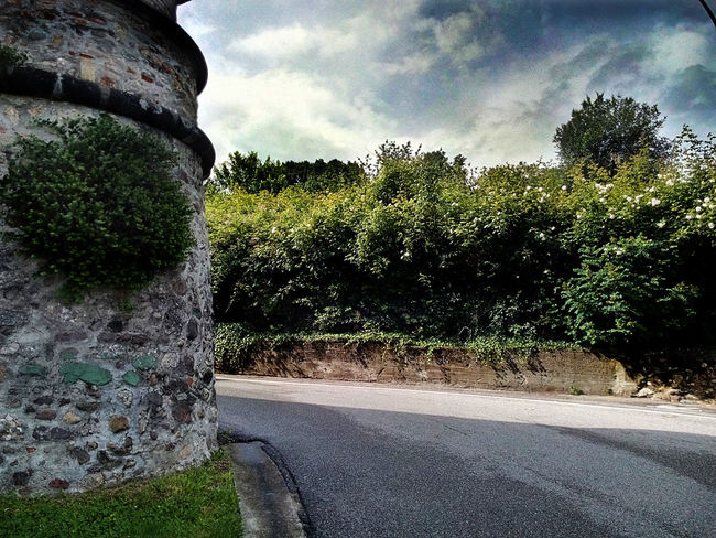Cloud Cloud - Sky Cloudy Country Road Day Diminishing Perspective Empty Empty Road Green Color Growth Landscape Nature No People Outdoors Plant Road Rovato Castello Quistini Scenics Sky The Way Forward Torrione Del Castello Tranquil Scene Tranquility Tree Vanishing Point