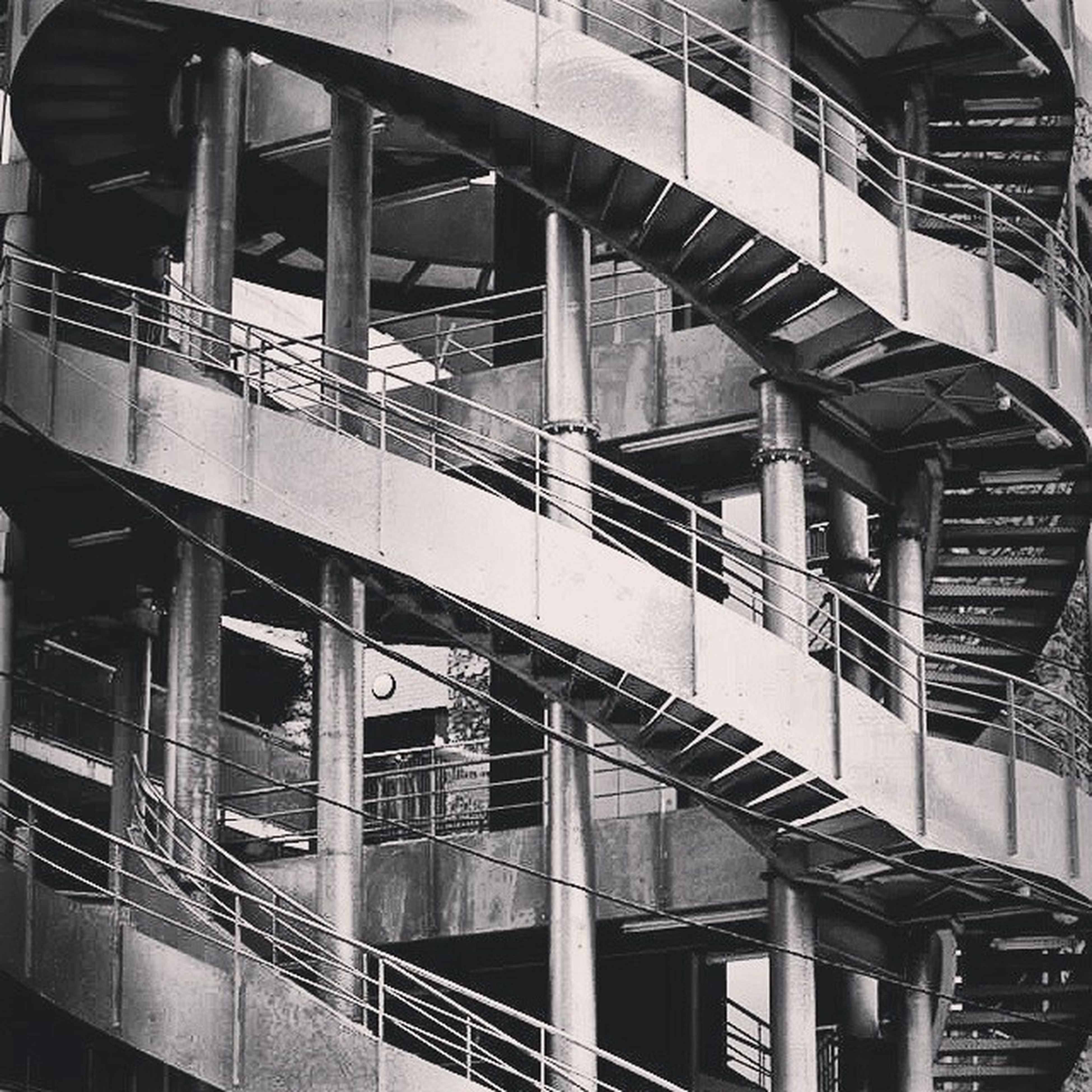 architecture, built structure, building exterior, transportation, railing, arch, rail transportation, public transportation, bridge - man made structure, staircase, connection, steps, railroad station, high angle view, indoors, travel, steps and staircases, building, train - vehicle, architectural column