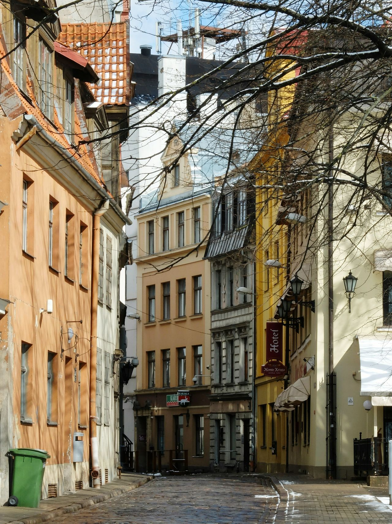 Architecture Building Exterior Built Structure Day City No People Residential Building Outdoors Low Angle View Sky Water Tree The Street Photographer - 2017 EyeEm Awards Walking Around City Riga Riga Old Town Spring Snow Cold Street Life City View  Latvia
