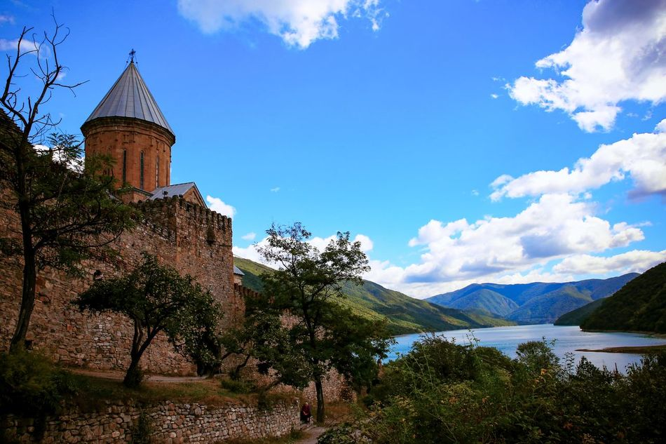 Ananuri's fortress, is located on the military Georgian road. Ananuri Beauty In Nature Blue Church Cloud - Sky Day Fortress Georgia Landscape Monastery Mountain Nature No People Outdoors Sky Travel Travel Destinations Tree Vacations