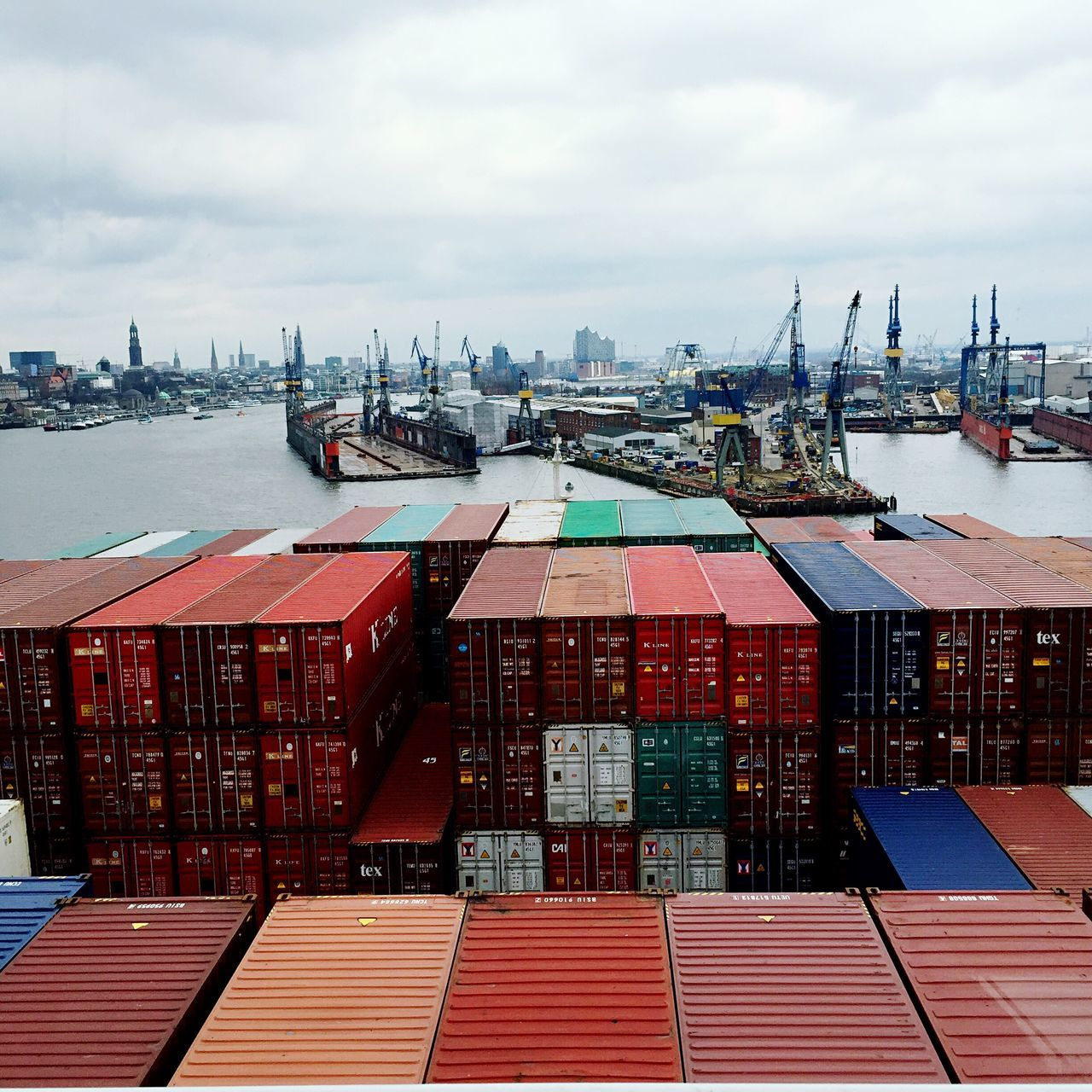Cargo Container Freight Transportation Commercial Dock Shipping  Harbor Industry Transportation Sky High Angle View Shipyard Large Group Of Objects From Above  Hamburg Shipping  Container Ship Captain Elbphilharmonie Harbor River No People Built Structure Outdoors Day Sea Water