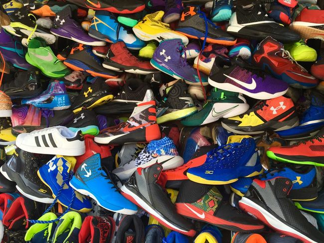 Colourful rubber shoes or sports shoes are displayed at a roadside stall in Zamboanga City in southern Philippines. Rubber Shoes Sports Shoes Sportswear Sports Wear Athletes Foot Athletes Shoes Color Photography Colourful Photography For Sale Zamboanga Sports