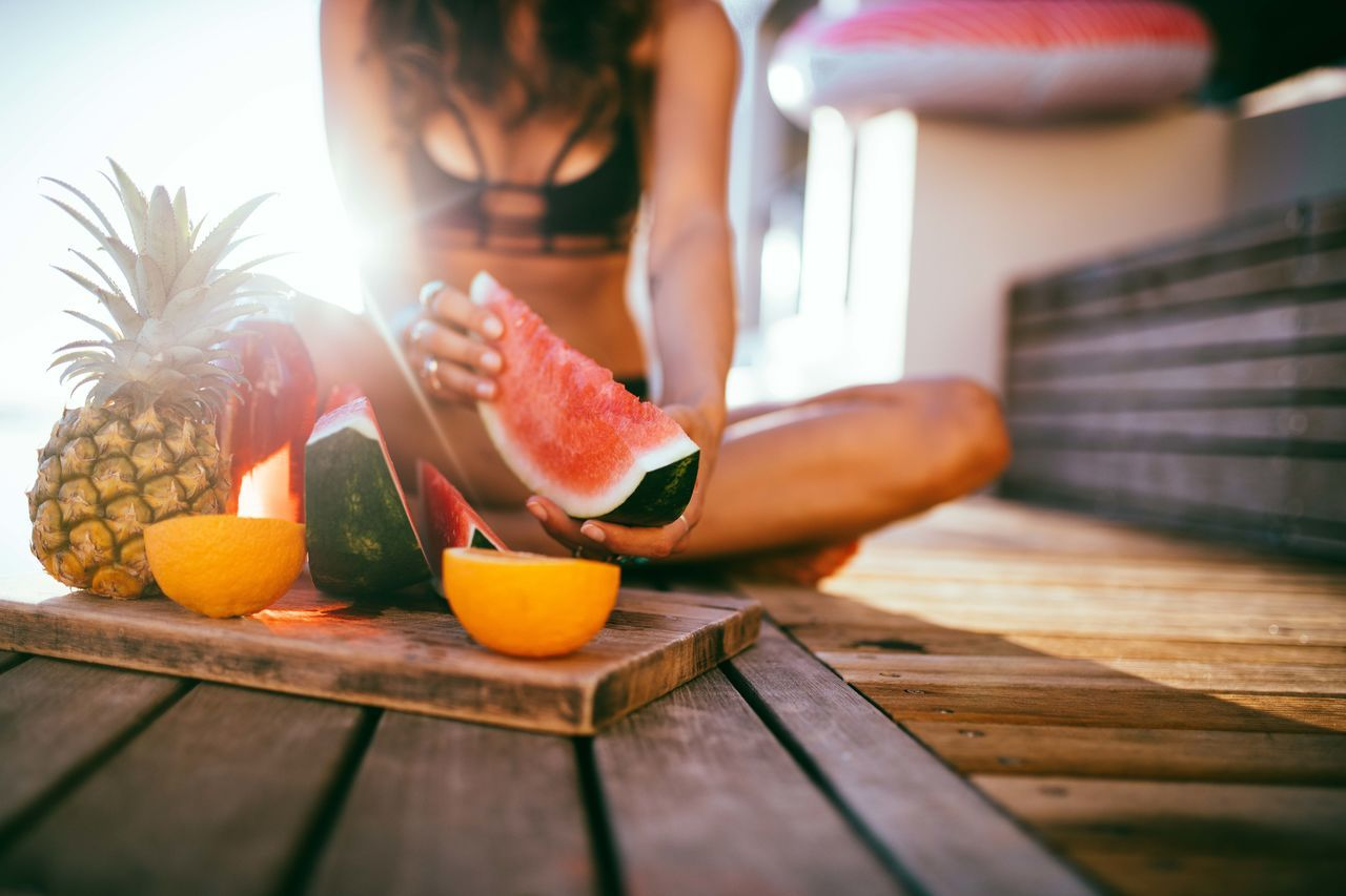Bikini Eating Eating Healthy Fresh Freshness Fruit Healthy Eating Healthy Food Healthy Lifestyle Human Hand Lifestyles Orange Outdoors People Pineapple Pool Pool Day  Summer Swimming Pool Swimwear Watermelon Women