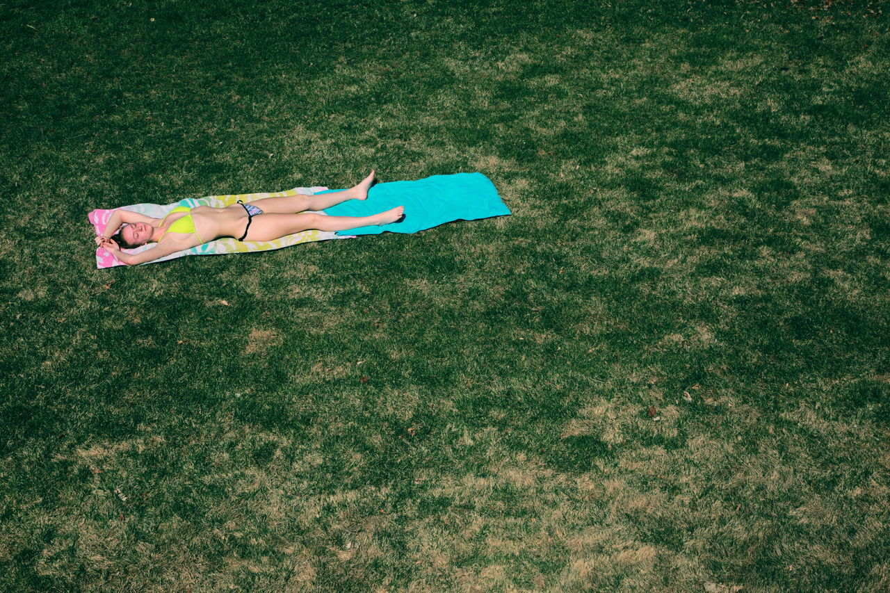 Sunbathing on a warm winter day in Utah. it was 75 degrees F (24 Celsius) in the middle of March, unseasonably warm for March in Utah. A record breaking warm day. Backyard Bikini Day Girl Grass Green Lawn Love Minimalism Outdoors Outside People Portrait Relaxing Season  Spring Sunbathing Sunshine Tanning Teenager Utah Warm Weather Winter