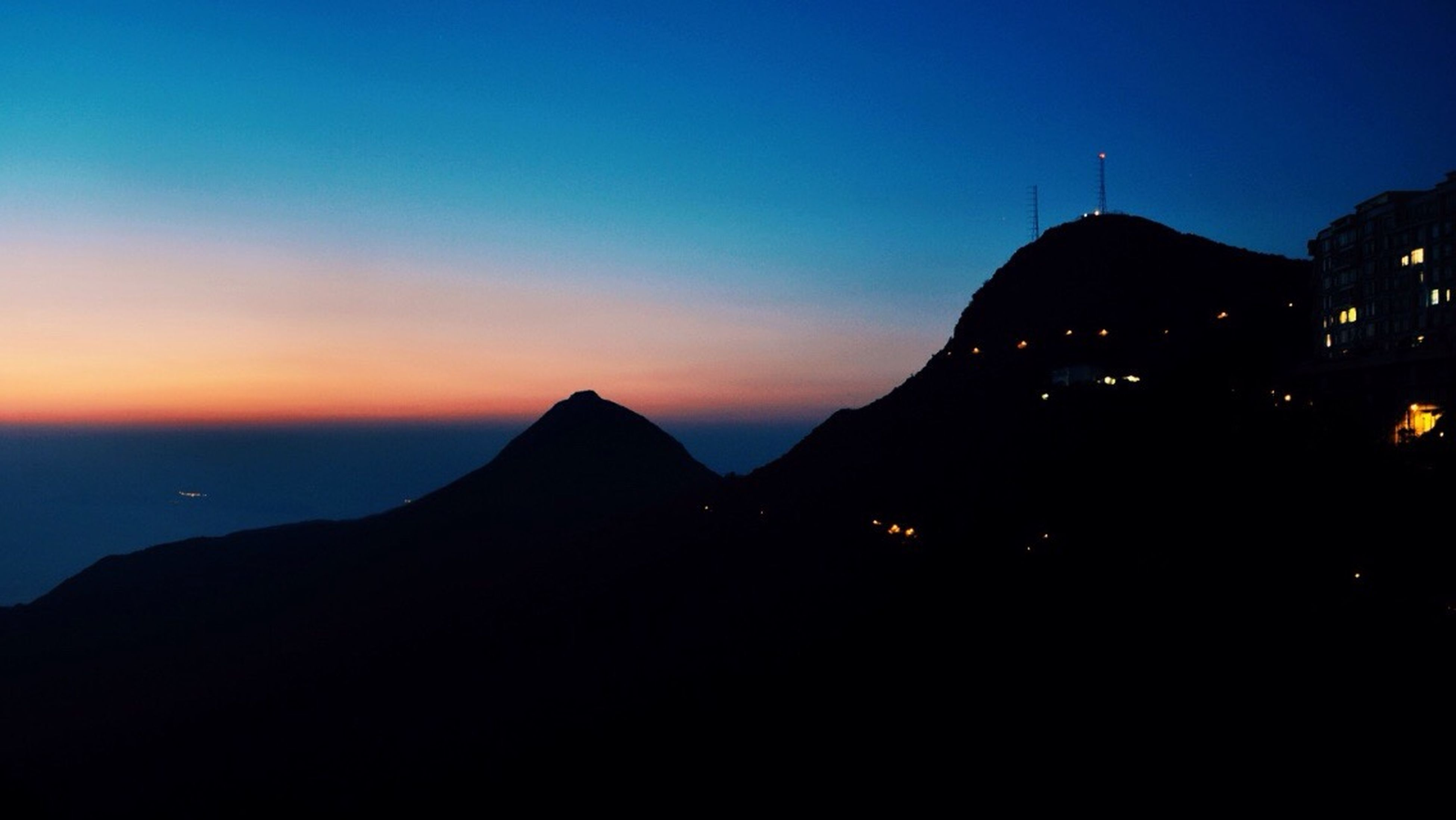 mountain, silhouette, sunset, scenics, mountain range, beauty in nature, tranquil scene, tranquility, dusk, copy space, sky, clear sky, nature, blue, idyllic, orange color, outdoors, illuminated, landscape, majestic