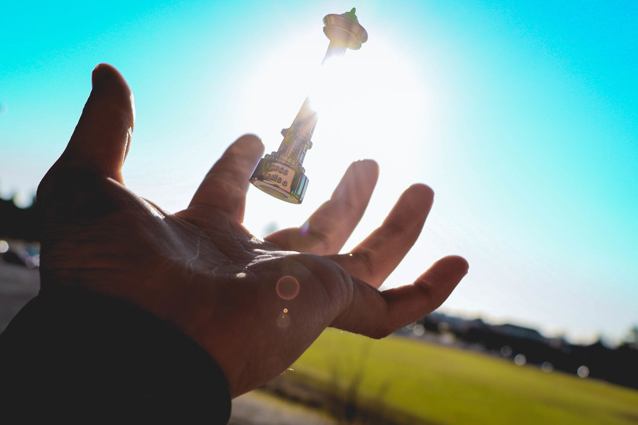 Training to beat Magneto Human Hand Sky Sunlight Human Body Part Outdoors One Person Shutter Fast POV Spaceneedle Levitation Photography Levitation Floating Float Magic Souvenirs Souvenir Close-up Gesturing Human Finger Freshness Shadow Lensflares Lensflare