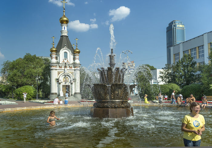 Russia, Yekaterinburg, fountains, heat, youth Architecture Blue Built Structure Capital Cities  City City Life Day Leisure Activity Lifestyles Outdoors Russia, Yekaterinburg, Fountains, Heat, Youth Sky Tourism Tourist Travel Destinations Tree Vacations Water