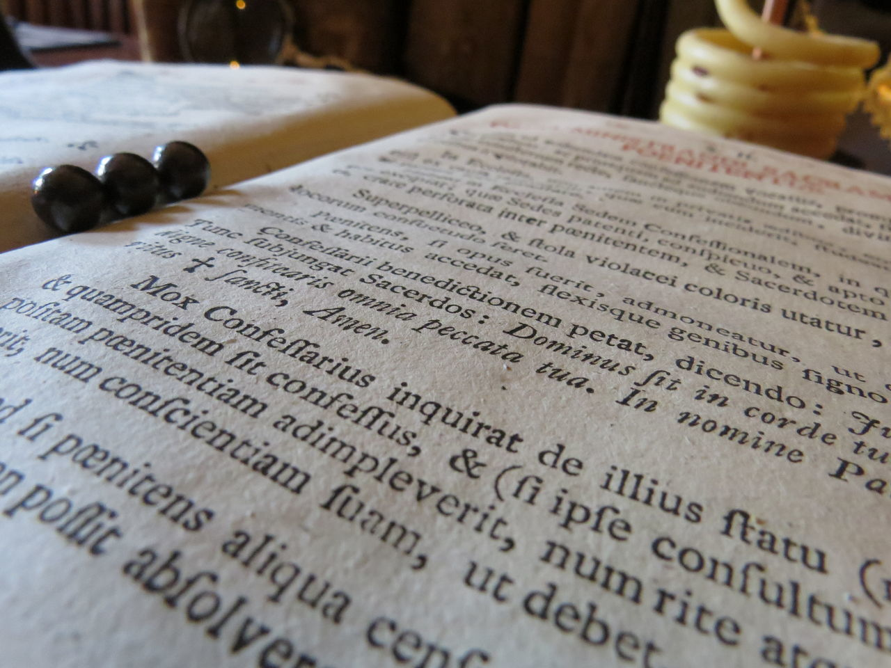 text, book, paper, indoors, religion, communication, no people, spirituality, close-up, literature, musical note, day