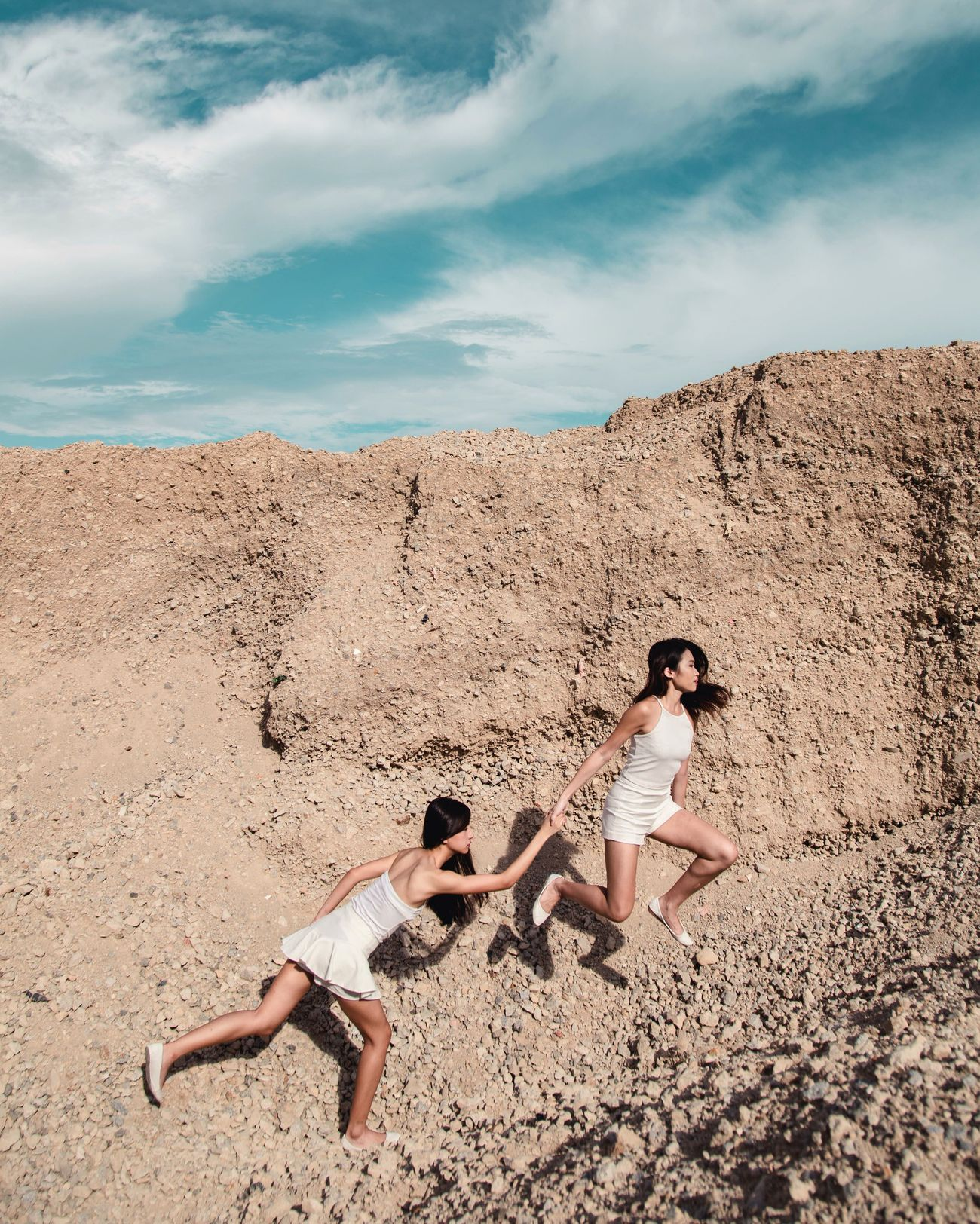 Leap of faith Sand Beach Summer Two People Girls Togetherness Friendship Females Outdoors Sand Dune The Portraitist - 2017 EyeEm Awards Light Women Around The World Portrait Photography Beautiful People Light Collection Place Of Heart The Great Outdoors - 2017 EyeEm Awards Leap Of Faith