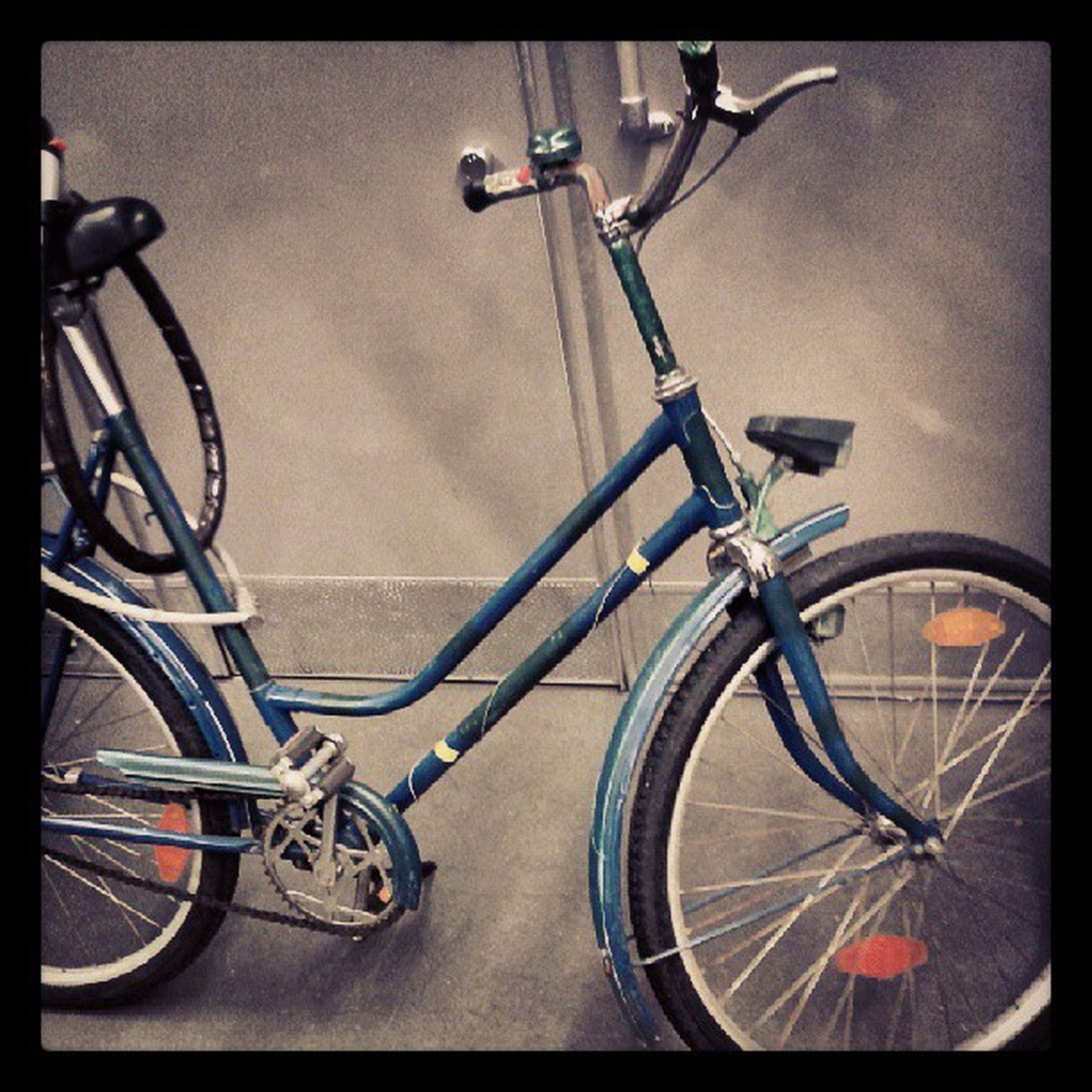 bicycle, transportation, mode of transport, land vehicle, stationary, parked, parking, transfer print, auto post production filter, wheel, travel, indoors, cycle, no people, leaning, wall - building feature, parking lot, street, absence, day