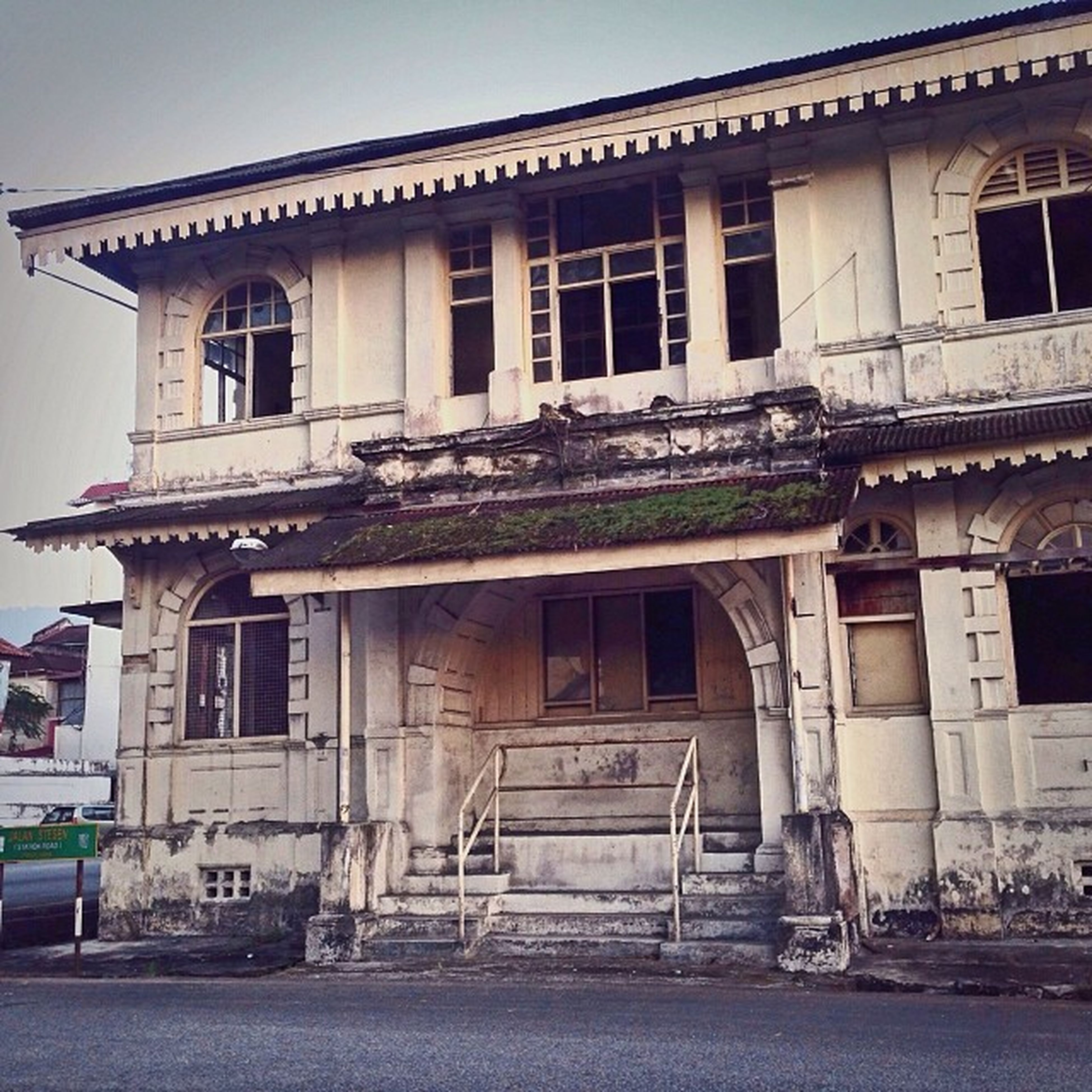 architecture, built structure, building exterior, old, window, abandoned, building, low angle view, history, damaged, obsolete, transportation, run-down, weathered, facade, day, outdoors, deterioration, sky, residential building