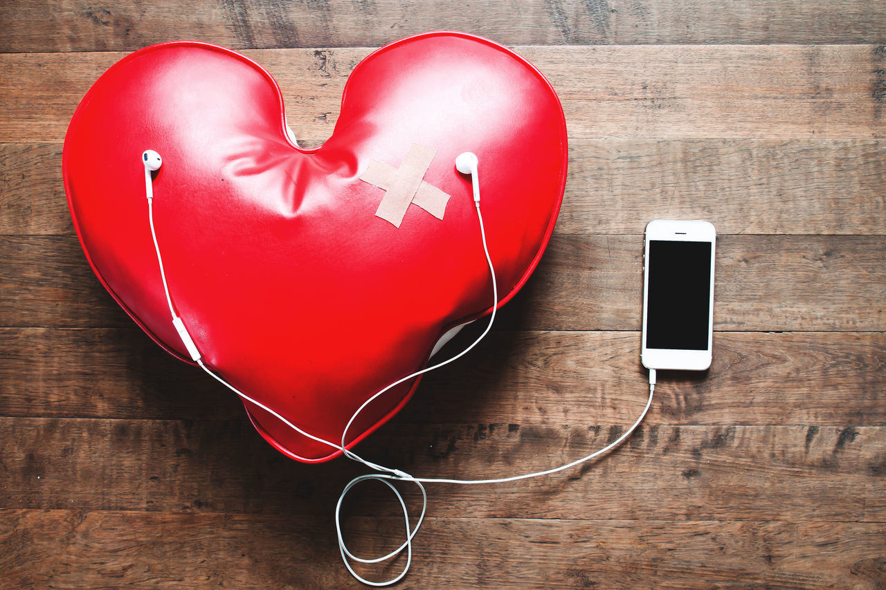 Broken heart listening to music, Love concept Background Broken Heart Communication Concept Conceptual Connection Heart Shape Indoors  Listening To Music Love Love And Care No People Red Samrtphon Technology Wireless Technology Wood Wood - Material Wooden