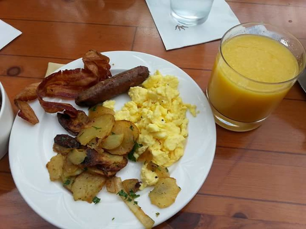Breakfast Hotel Breakfast Eggs... Sausage Potatoes Orange Juice  Delicious Oprylandresort Bacon!