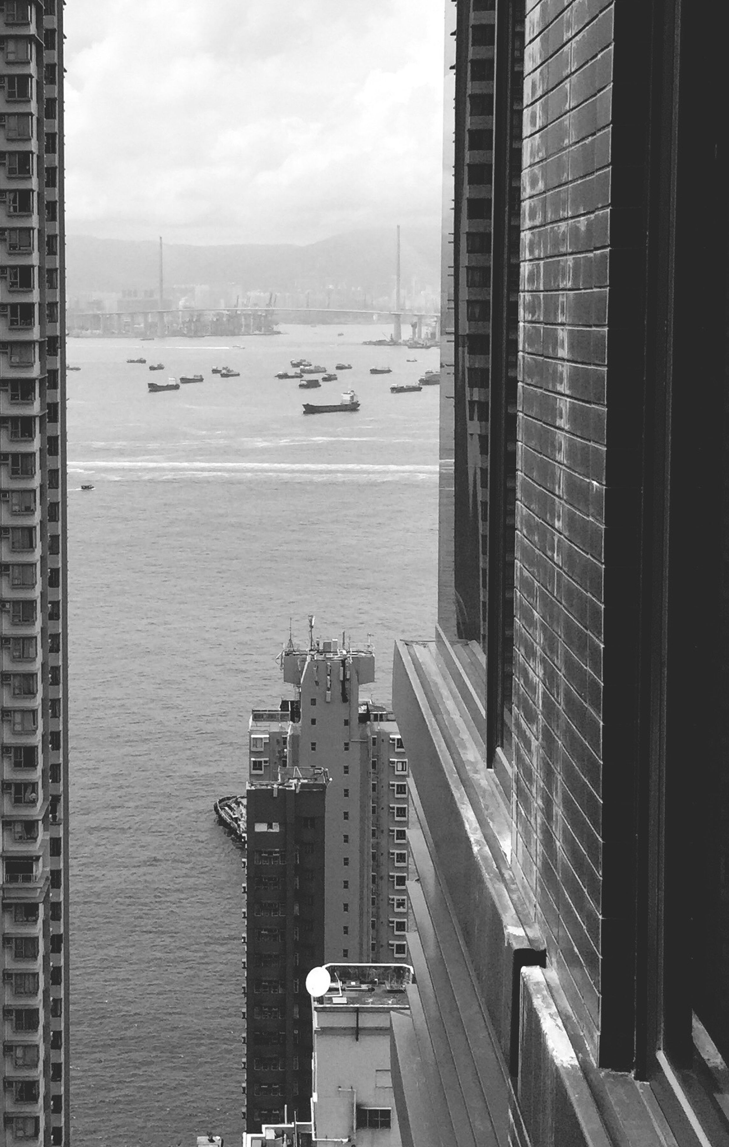 transportation, architecture, mode of transport, nautical vessel, built structure, city, water, boat, sky, harbor, cityscape, cloud - sky, modern, office building, outdoors, no people, ship, development, day, tall - high, city life, nature