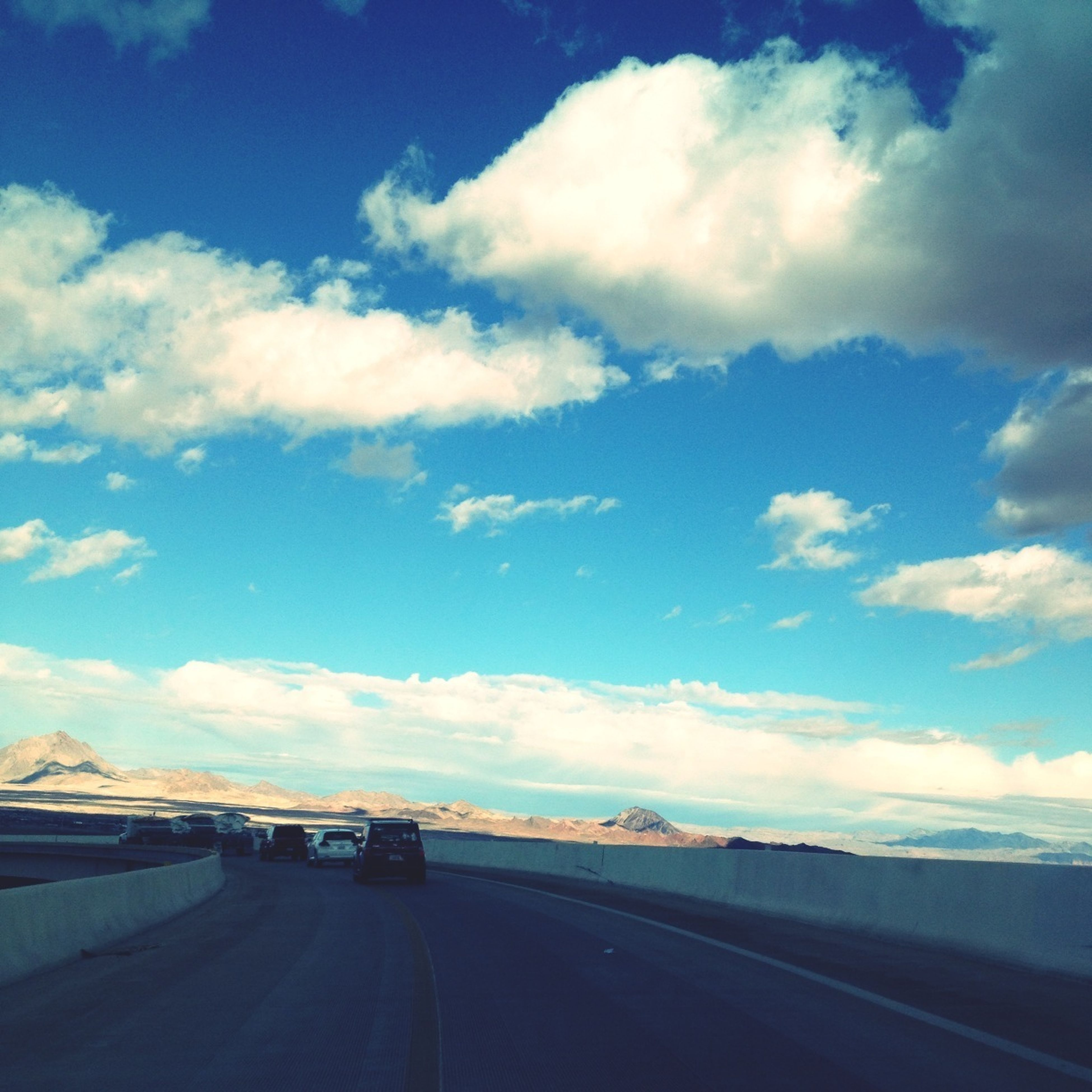 transportation, road, sky, the way forward, cloud - sky, road marking, cloud, blue, diminishing perspective, car, vanishing point, cloudy, street, mode of transport, land vehicle, highway, nature, country road, day, outdoors