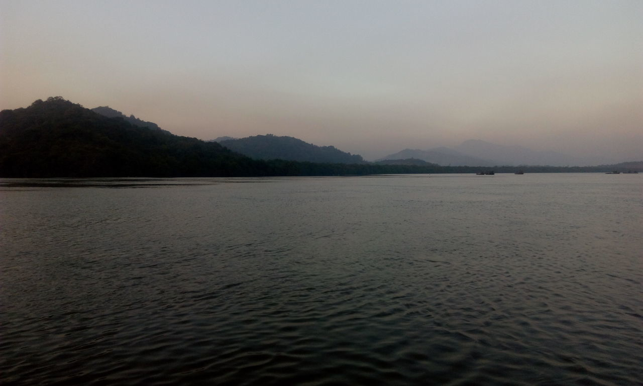 nature, tranquility, water, mountain, tranquil scene, beauty in nature, scenics, no people, outdoors, clear sky, sea, sky, day
