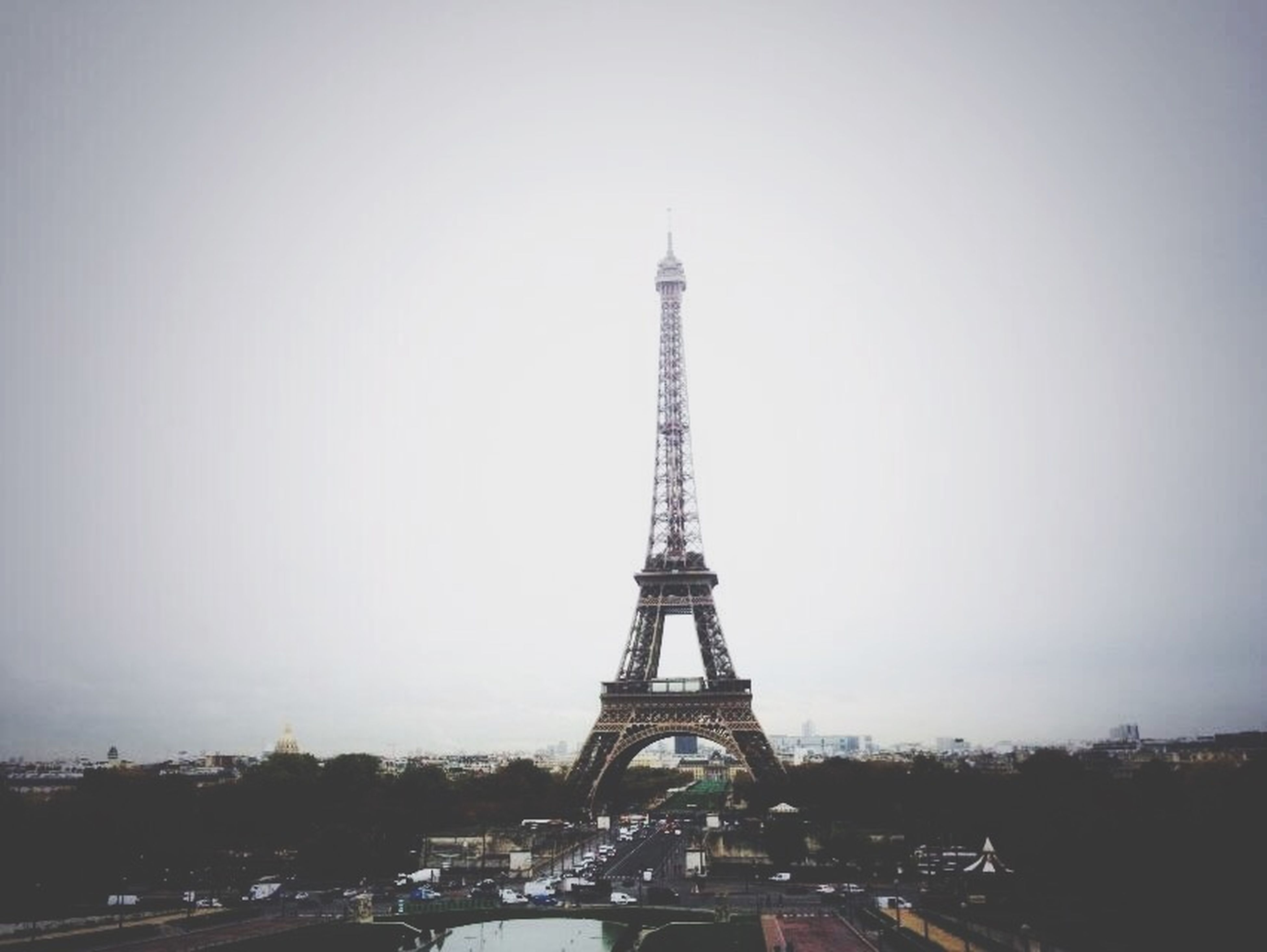 eiffel tower, built structure, architecture, tower, tall - high, international landmark, famous place, travel destinations, capital cities, tourism, travel, culture, clear sky, city, metal, sky, building exterior, copy space, communications tower, low angle view
