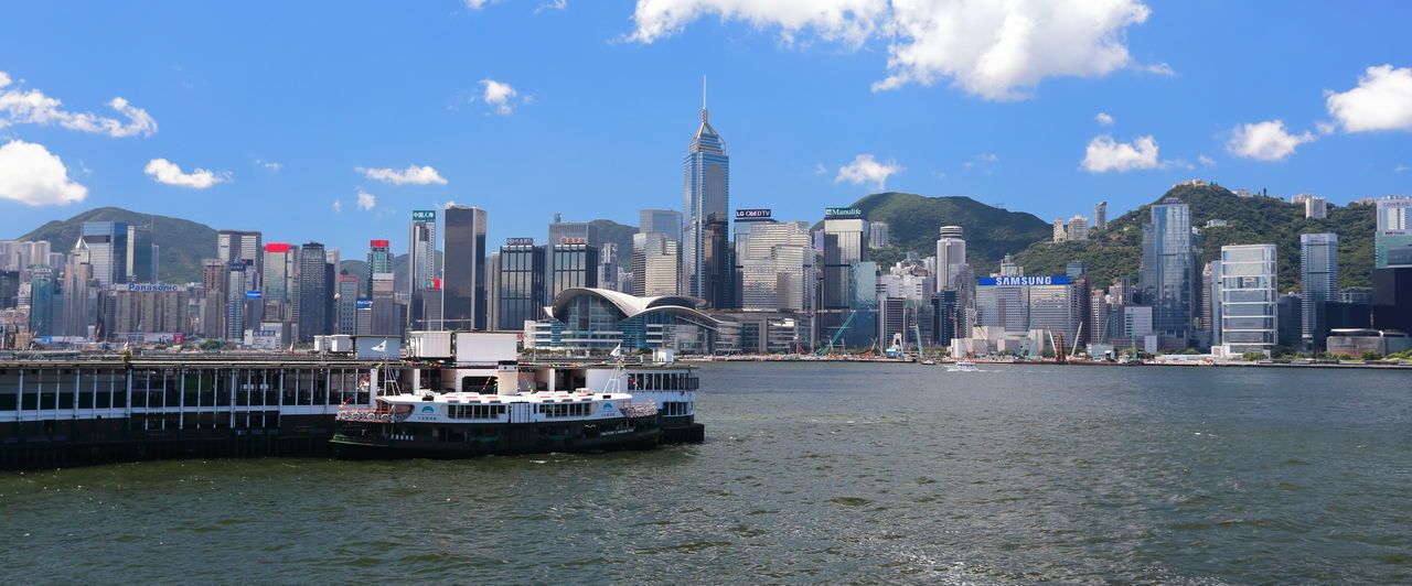 Architecture Boat Building Exterior Built Structure City Cityscape Cloud - Sky Financial District  Hanging Out Hong Kong Habour Hong Kong Star Ferry Hong Kong Victoria Harbour International Landmark Mode Of Transport Modern Office Building Skyscraper Travel Destinations Urban Skyline Water Waterfront Wharfside