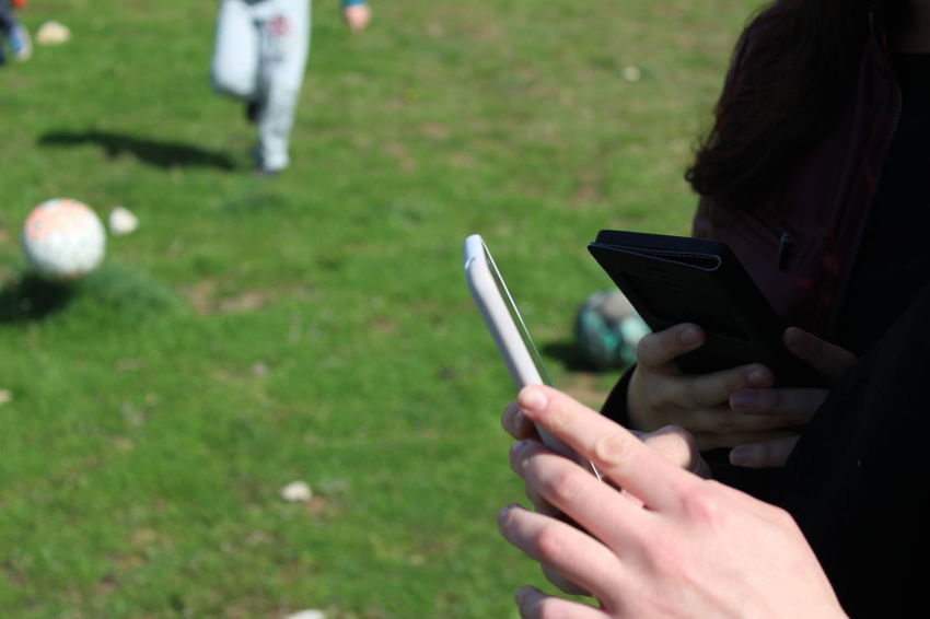 technology Close-up Field Focus On Foreground Grass Green Color Mobile Phone Person Phone Phones Selective Focus Single Object Technology Technology I Can't Live Without