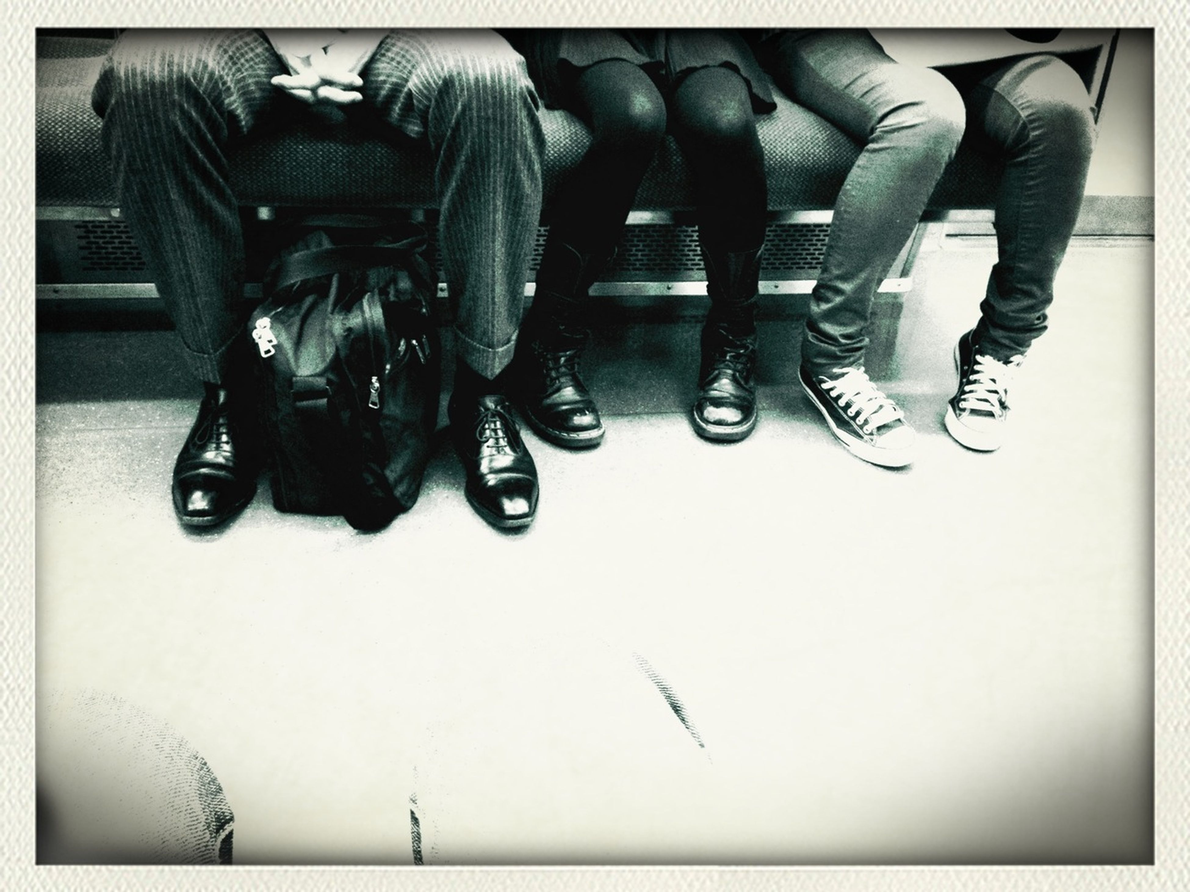transfer print, indoors, auto post production filter, men, lifestyles, leisure activity, high angle view, person, low section, shoe, in a row, togetherness, hanging, technology, arts culture and entertainment, standing