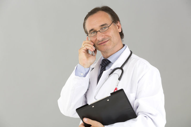 Stethoscope  Reassurance Speaking On The Phone Talking On The Phone Portrait Doctor  Medical Real People Standing Occupation Holding Person Man With Glasses Medical Team