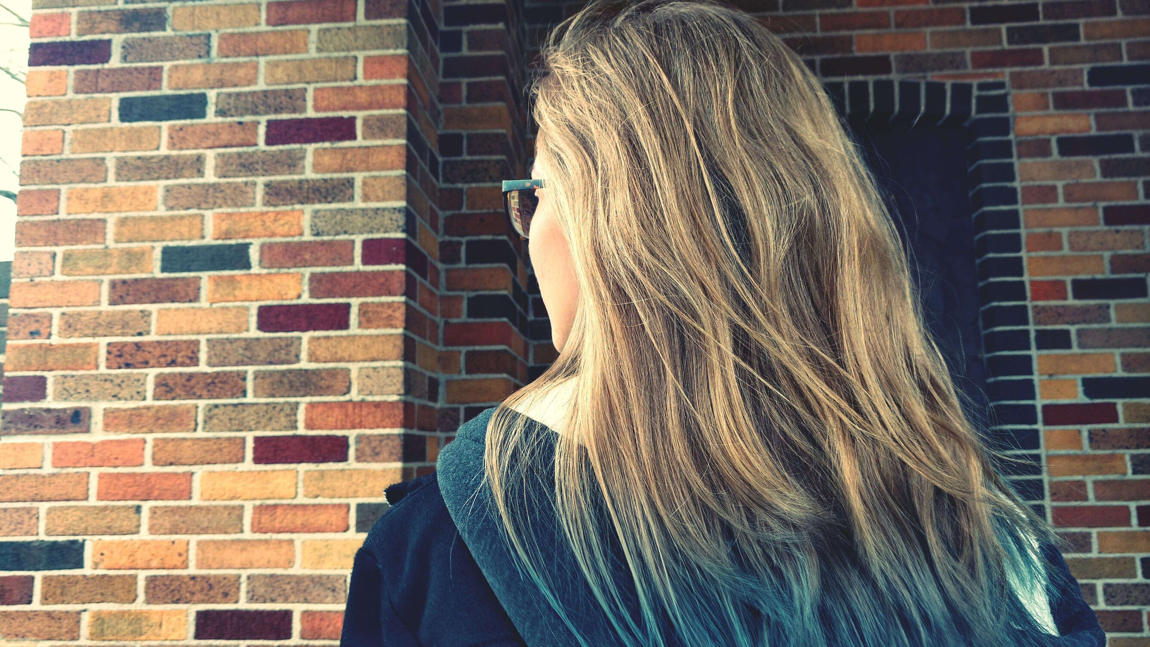 brick wall, lifestyles, real people, headshot, one person, women, day, close-up, outdoors, young women, people, adult