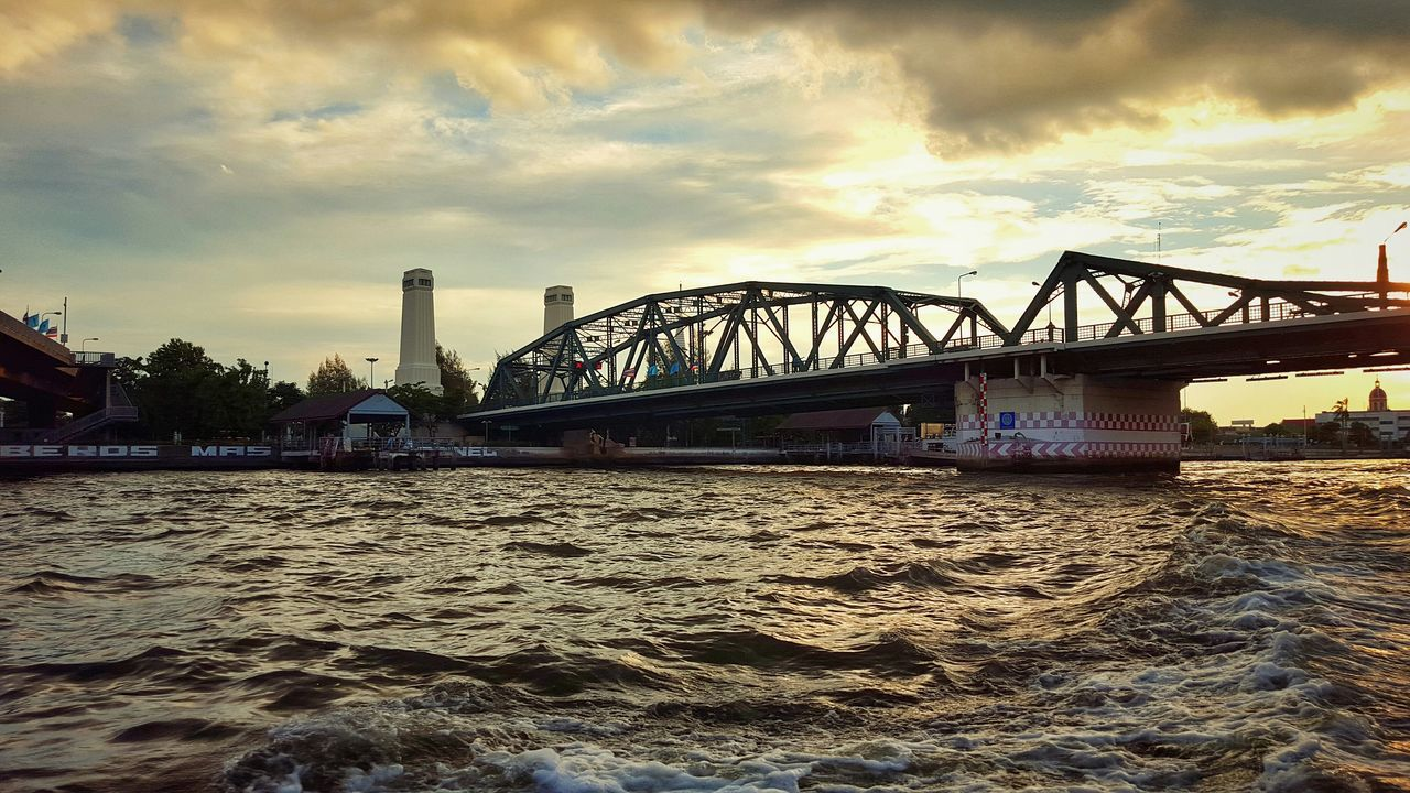 bridge - man made structure, connection, engineering, built structure, architecture, sky, transportation, cloud - sky, river, water, low angle view, no people, waterfront, travel, outdoors, bridge, travel destinations, sunset, city, nature, building exterior, day