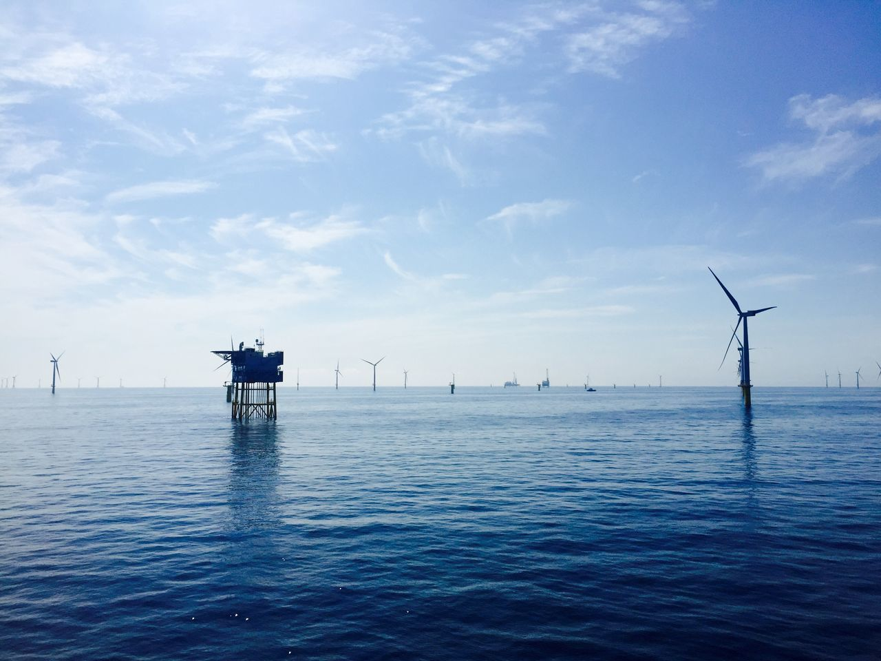 sea, water, waterfront, sky, beauty in nature, nautical vessel, cloud - sky, nature, scenics, tranquility, tranquil scene, transportation, day, outdoors, mode of transport, horizon over water, wind power, no people, wind turbine, blue, windmill