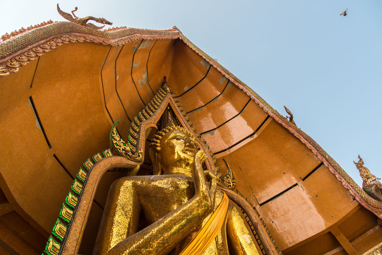 statue, sculpture, gold colored, religion, no people, low angle view, outdoors, architecture, day, sky