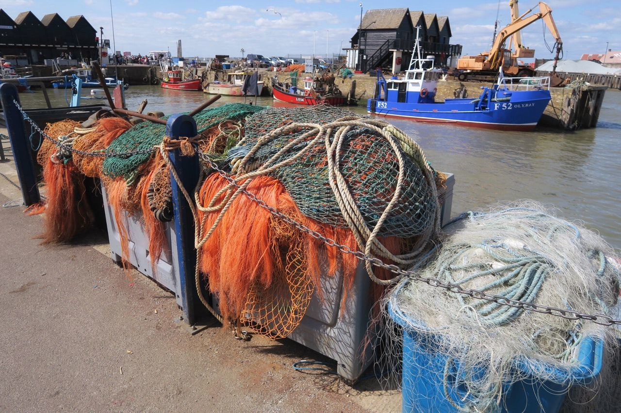 Fishing nets in Whitstable Kent England Fishing Industry Harbor Industry Fishing Net Nautical Vessel Transportation Water Day Outdoors No People Moored Fishing Tackle Architecture Sky