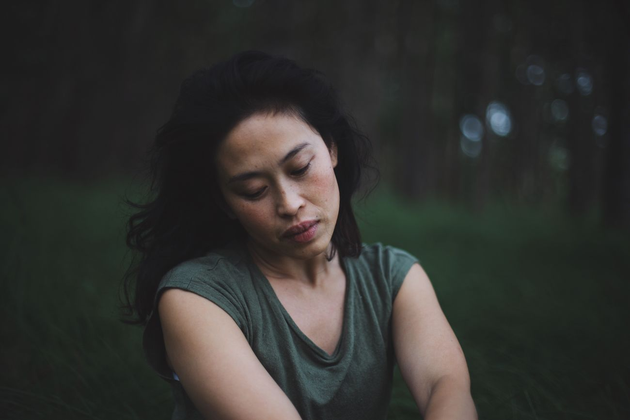 Disappointment Emotional Stress Worried Young Adult One Person Depression - Sadness Tensed Real People Sitting Uncomfortable Young Women Outdoors Grief Day People