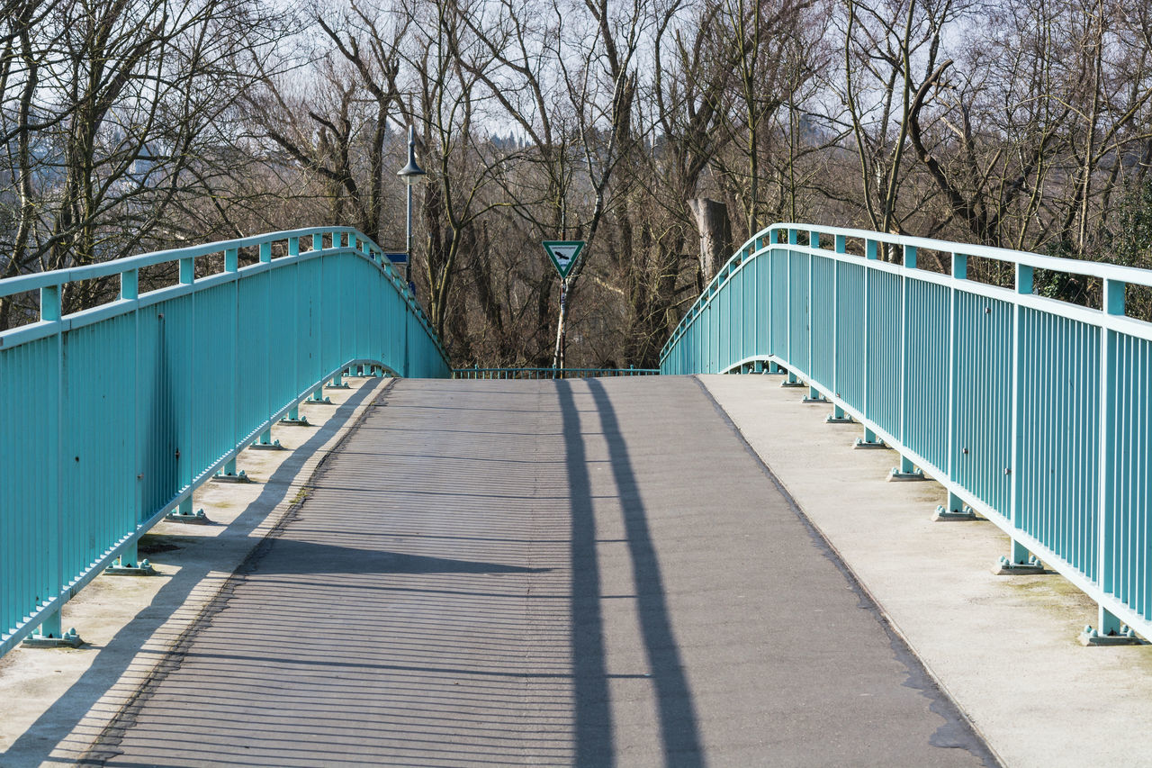 Pedestrian bridge steel arch structure over the river Ruhr in Muelheim, Germany. Arch Bridge Architecture Architecture_collection Bridge Bridge Building Construction Day Footbridge Iron Iron Bridge Nature No People Outdoors Railing Railling The Way Forward Tree