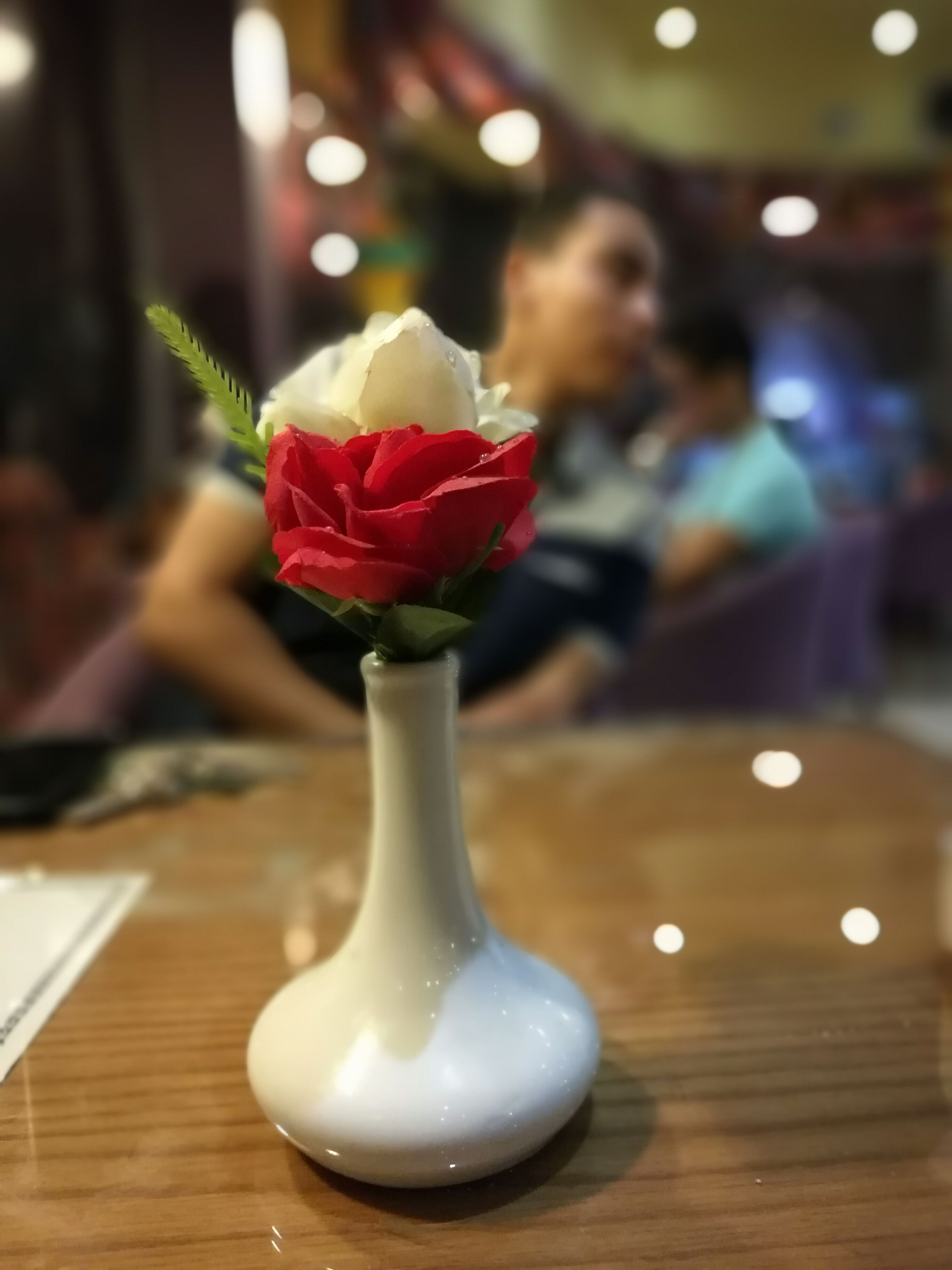 indoors, flower, table, focus on foreground, freshness, vase, red, close-up, still life, selective focus, fragility, decoration, pink color, petal, rose - flower, home interior, no people, flower head, wood - material, white color