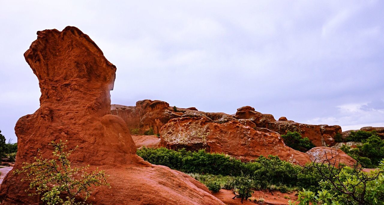 geology, rock formation, nature, rock - object, beauty in nature, tranquil scene, physical geography, sky, no people, tranquility, low angle view, day, outdoors, landscape, travel destinations, rock hoodoo, scenics