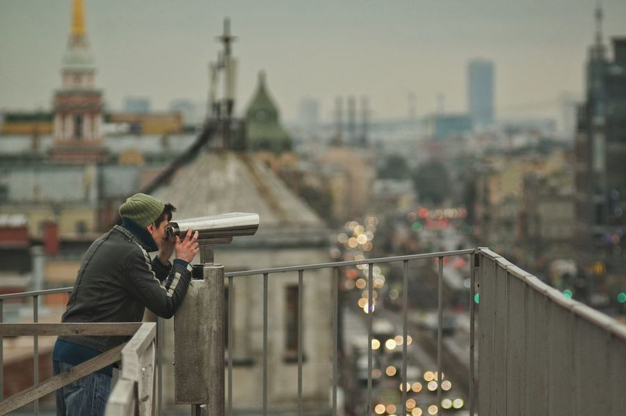 City One Person Cityscape Urban Skyline Architecture Person One Man Only Sightseeing Binocular Binocular Scope Building Structures Rooftop View  Rooftops Rooftop RoofCity SkylineRooftop View  Saint Petersburg Saint Petersburg, Russia Russia City View  Roofs Cityscape City View  Architecture