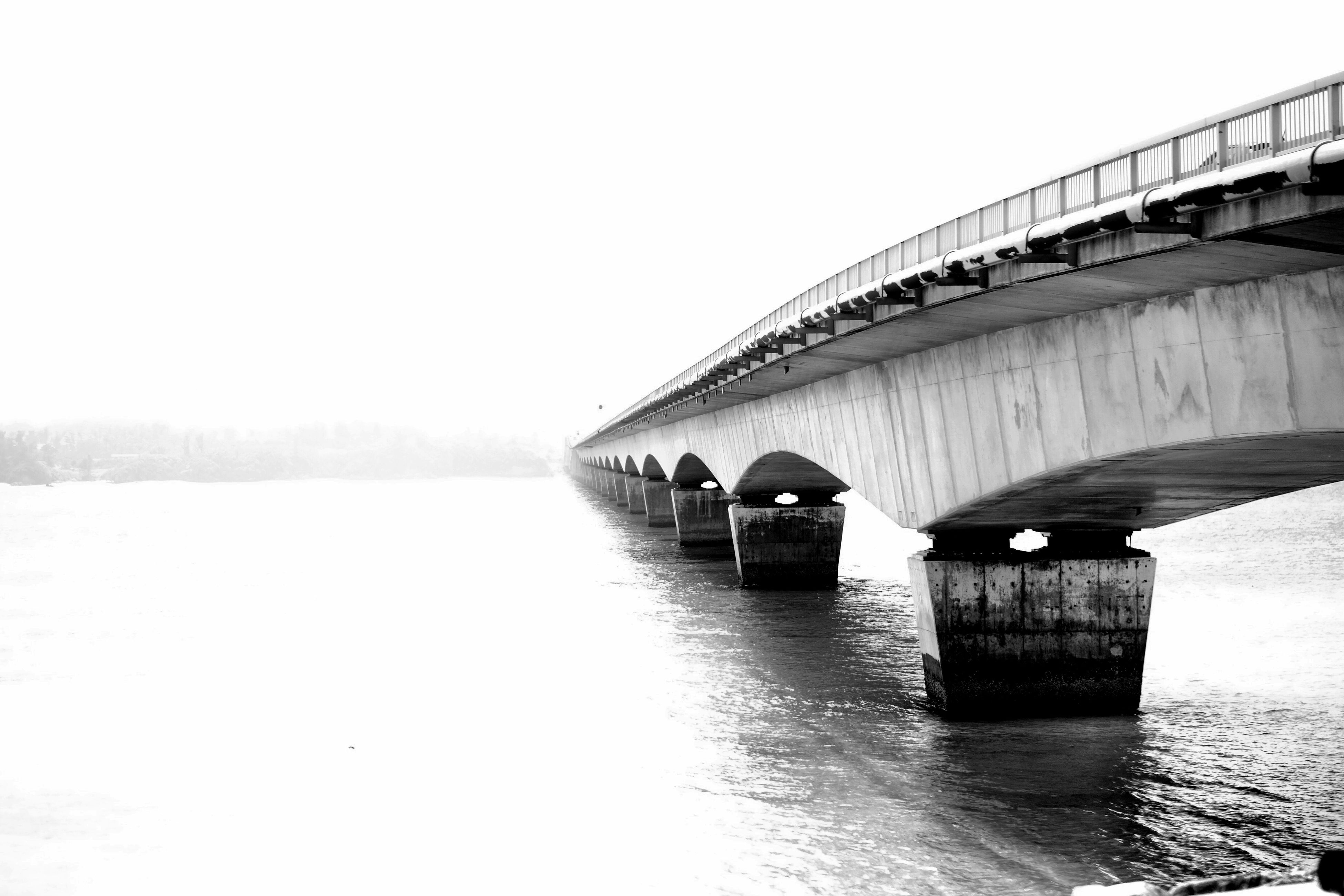 water, clear sky, waterfront, built structure, architecture, connection, river, bridge - man made structure, bridge, tranquil scene, tranquility, nature, engineering, outdoors, day, rippled, no people, scenics, beauty in nature, sky, calm, ocean, standing water, idyllic