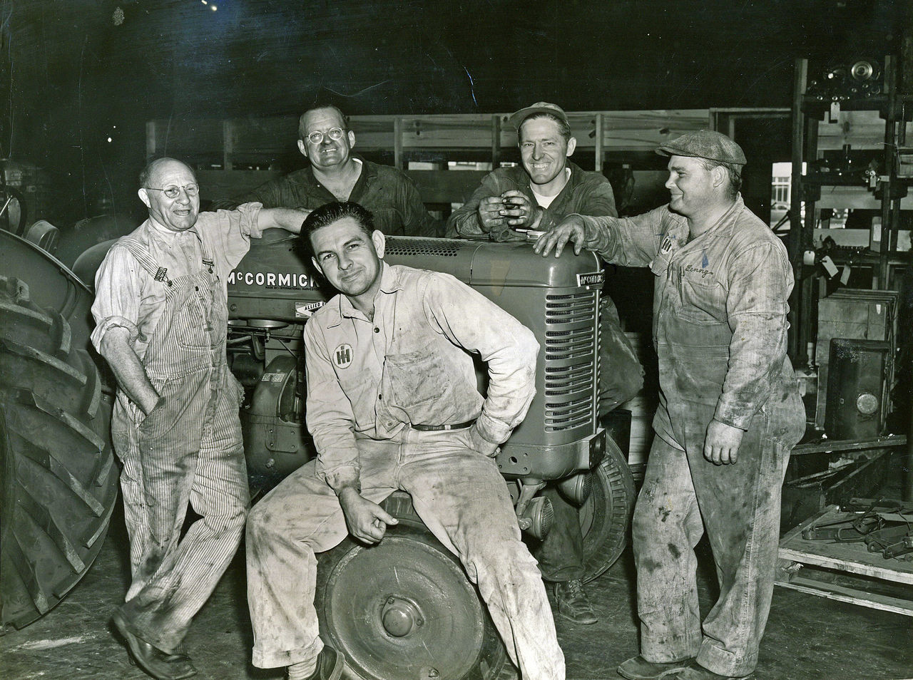 Mechanics on a tractor Looking At Camera Mechanic Mechanics Men Old Mechanics Old Pic  Old Pictures Old Tractor Old Tractor. Old Tractors Portrait Real People Tractor Vintage Photo Working Working Hard