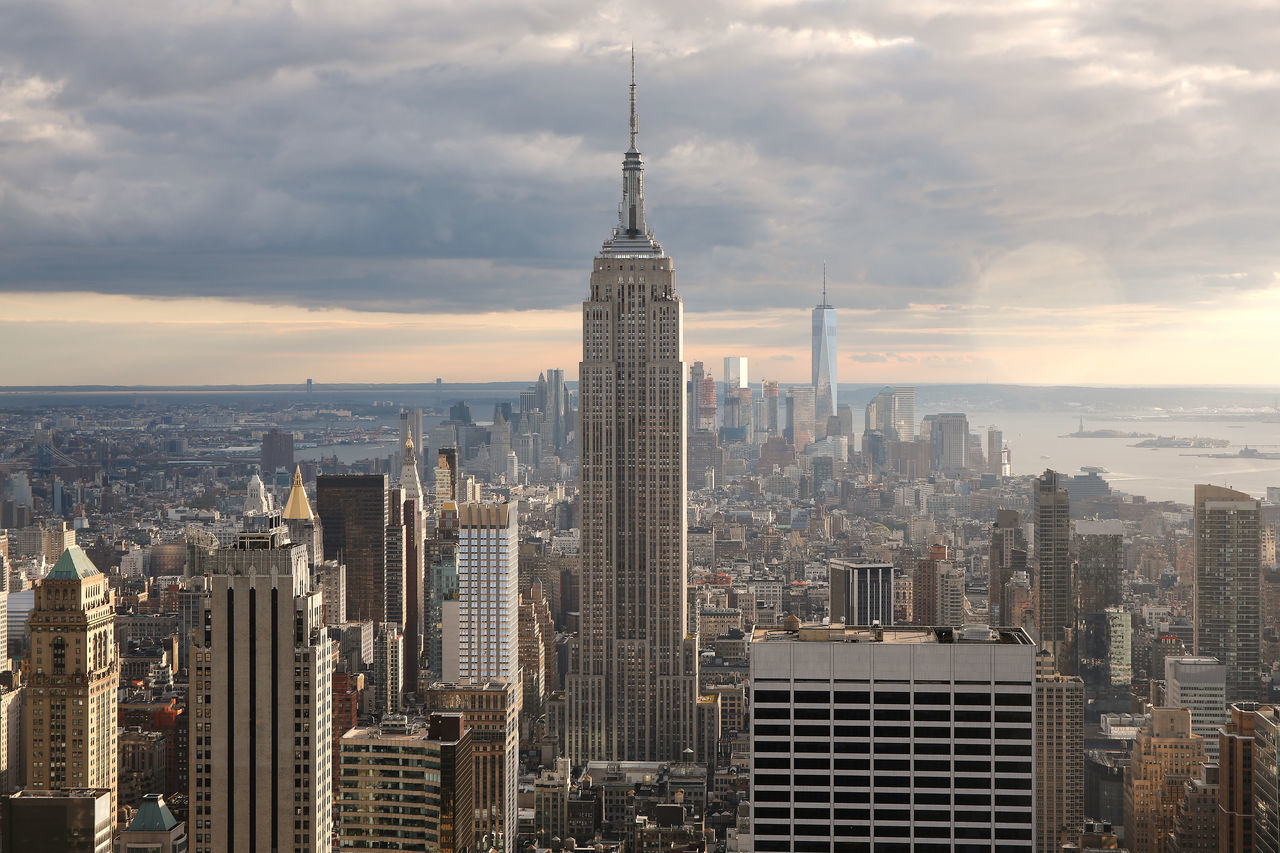 aerial view of manhattan financial district and the Empire State Building in New York during sunset Architecture Business Finance And Industry Cloudy Downtown Empire State Building Financial District  Freedom Tower Manhattan Manhattan New York Manhattan Skyline New York Skycrapers Skyline Sunset USA