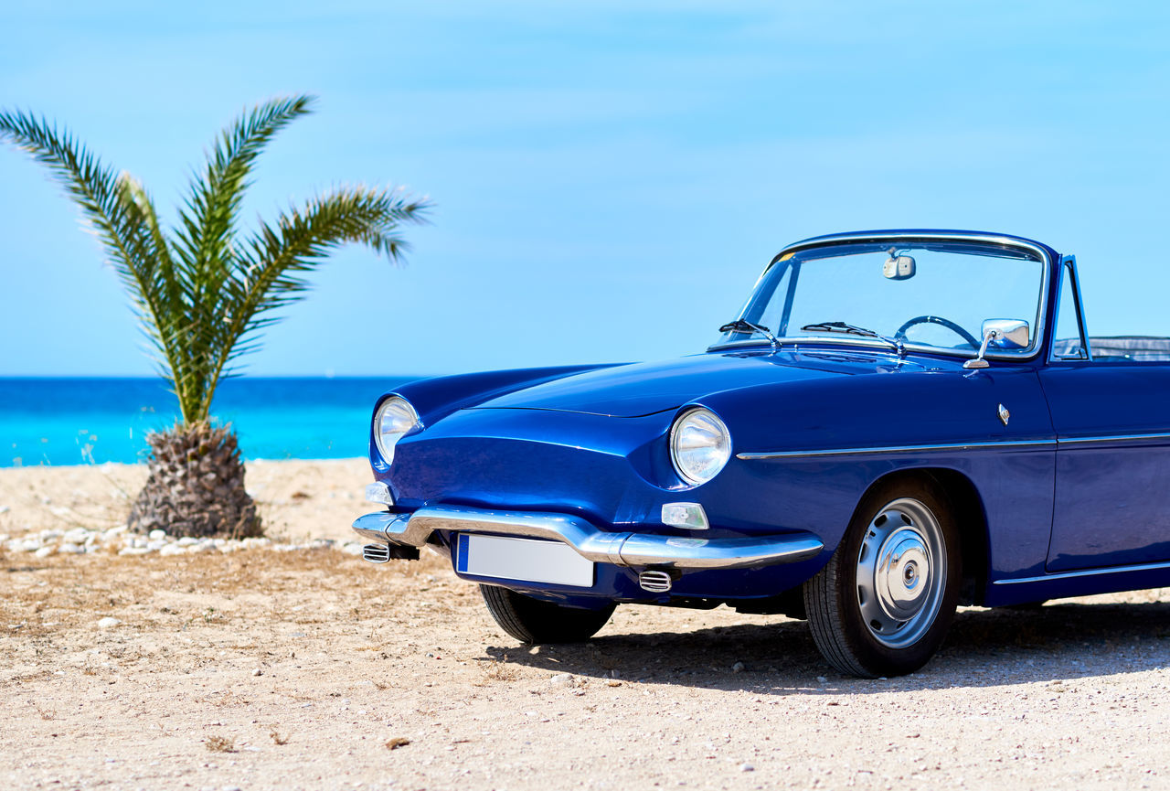 Retro cabriolet car on the beach near the turquoise sea. Idyllic scenery Auto Automobile Beach Cabriolet Journey Mode Of Transport No People Nostalgia Ocean Old Old-fashioned Outdoors Palm Tree Retro Car Retro Styled Scenery Sea Sky Sunny Day Transportation Travel Vehicle Vibrant Color Vintage Car Voyage
