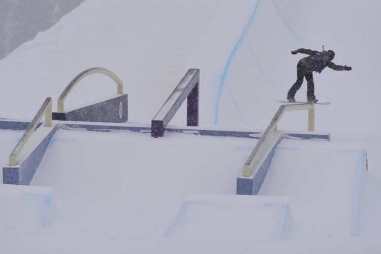 Snowy start to the Slopestyle competition at the Usopen of Snowboarding in Vail  Colorado . You never know what Mother Nature will deliver in the spring time in these beautiful Rocky Mountains ! Rider: Spencer O'Brien