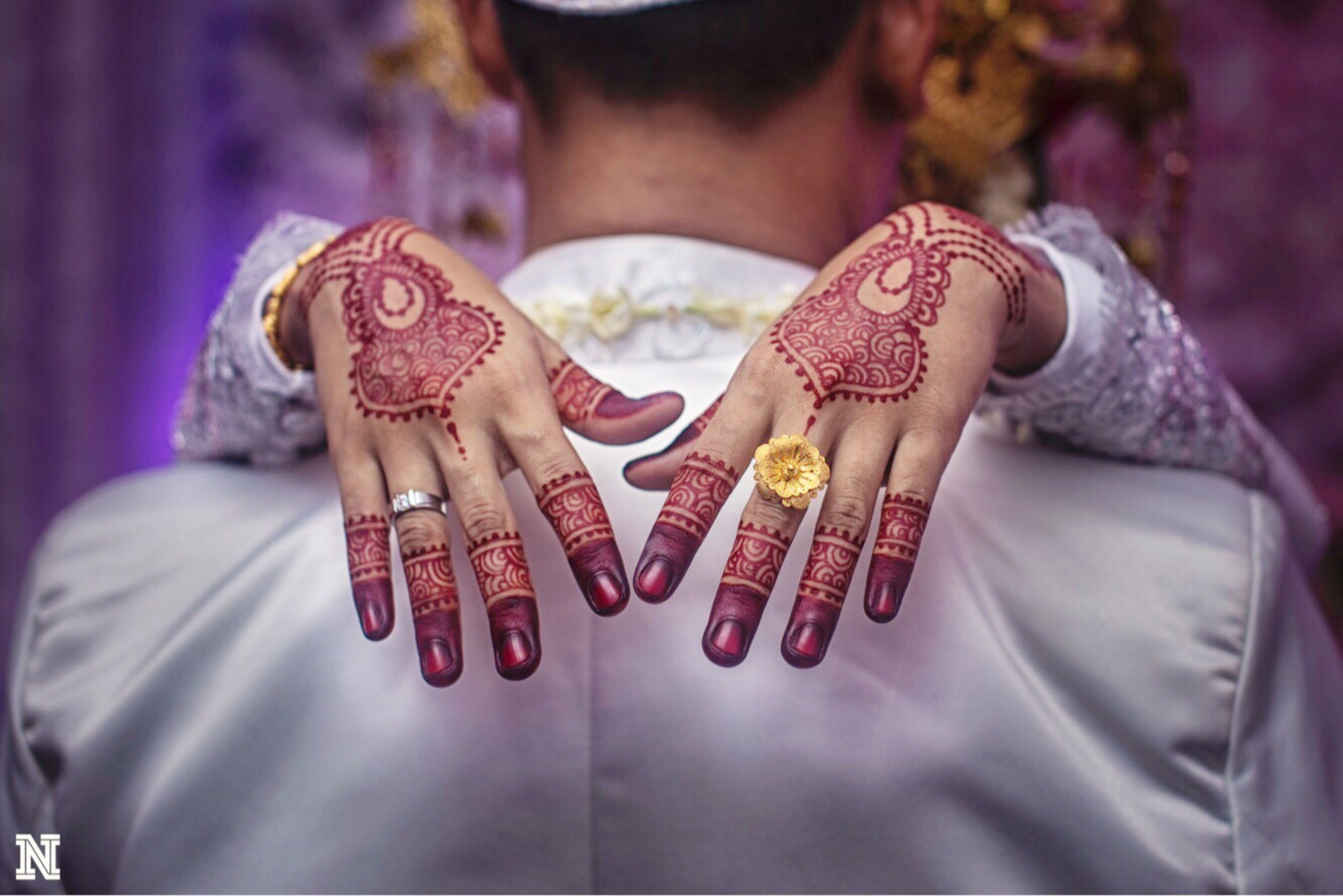 cultures, midsection, adults only, human hand, lifestyles, real people, adult, tradition, people, indoors, jewelry, one person, men, women, wedding ceremony, bangle, human body part, life events, wedding, bride, sari, close-up, wedding dress, young adult, day