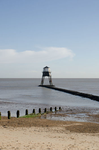 Dovercourt Low lighthouse with Beach in Foreground Architecture Clear Sky Essex Lighthouse Victorian Cast Iron Dovercourt Flat Landmark Old Sea Sky Warning