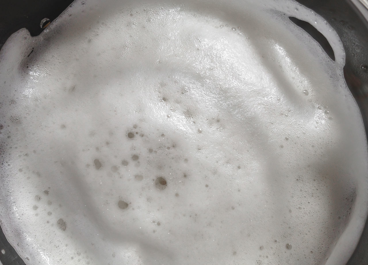 Light beer foam bubbles. Fresh beer foam. Top view, extreme close-up. Texture and background for many uses. Above Alcohol Alcoholic  Ale Background Bar Beer Beverage Bubbles Close-up Cold Drink Drop Foam Fresh Froth Gold Golden Lager Light Liquid Macro Pint Pub Refreshment