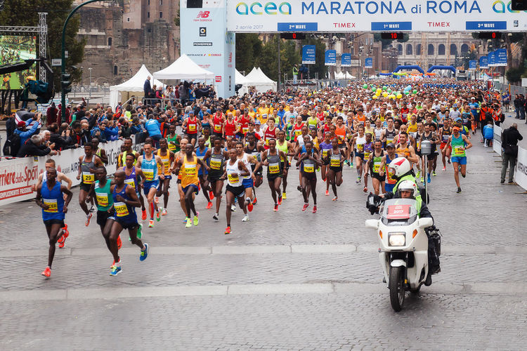 Rome, Italy - April 2, 2017: the departure of the athletes on Via dei Fori Imperiali, the Coliseum on background. In the foreground the Senegalese and Moroccan athletes Adult Athlete City City City Life Crowd Day Large Group Of People Marathon Marathon2017 Marathonrunner Outdoors People Rome Italy Rome Marathon Rome Marathon 2017 Rome Marathon 23rd Runner Runners Runnersworld