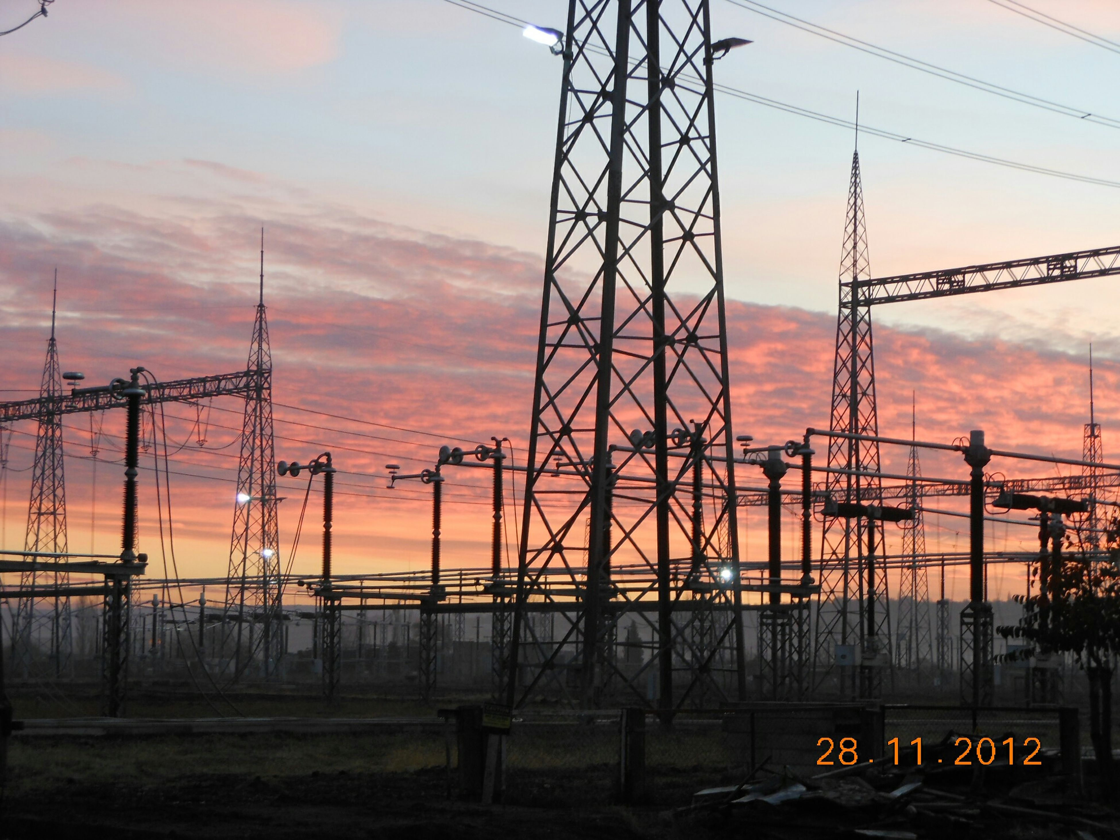 sunset, electricity pylon, sky, power line, silhouette, power supply, orange color, electricity, cloud - sky, connection, fuel and power generation, transportation, cable, technology, no people, nature, cloud, outdoors, dusk, low angle view